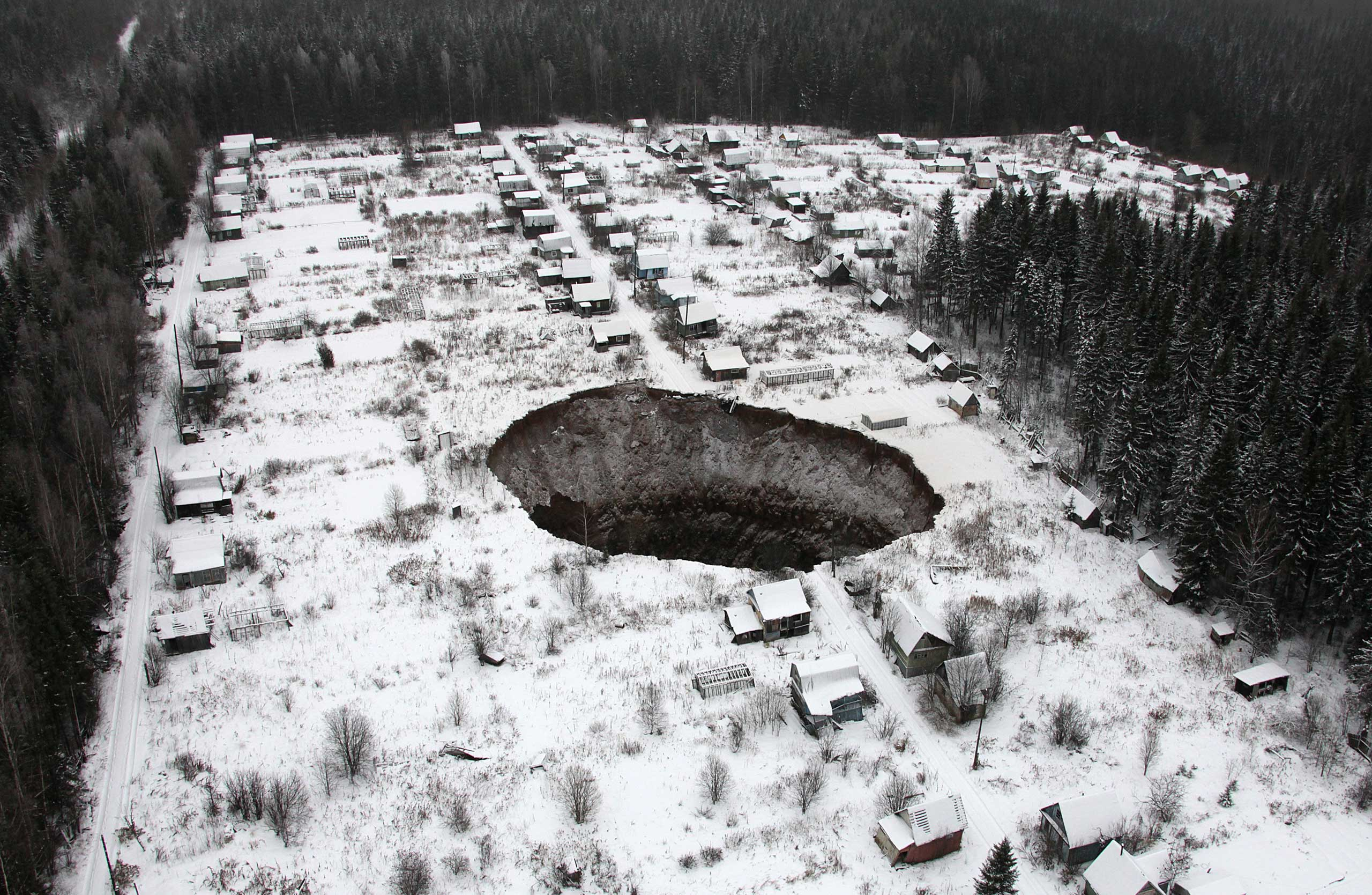 Nov. 20, 2014. A view of a sinkhole stretching 65 by 98 ft. at the Solikamsk-2 mine in the Perm region, Russia.