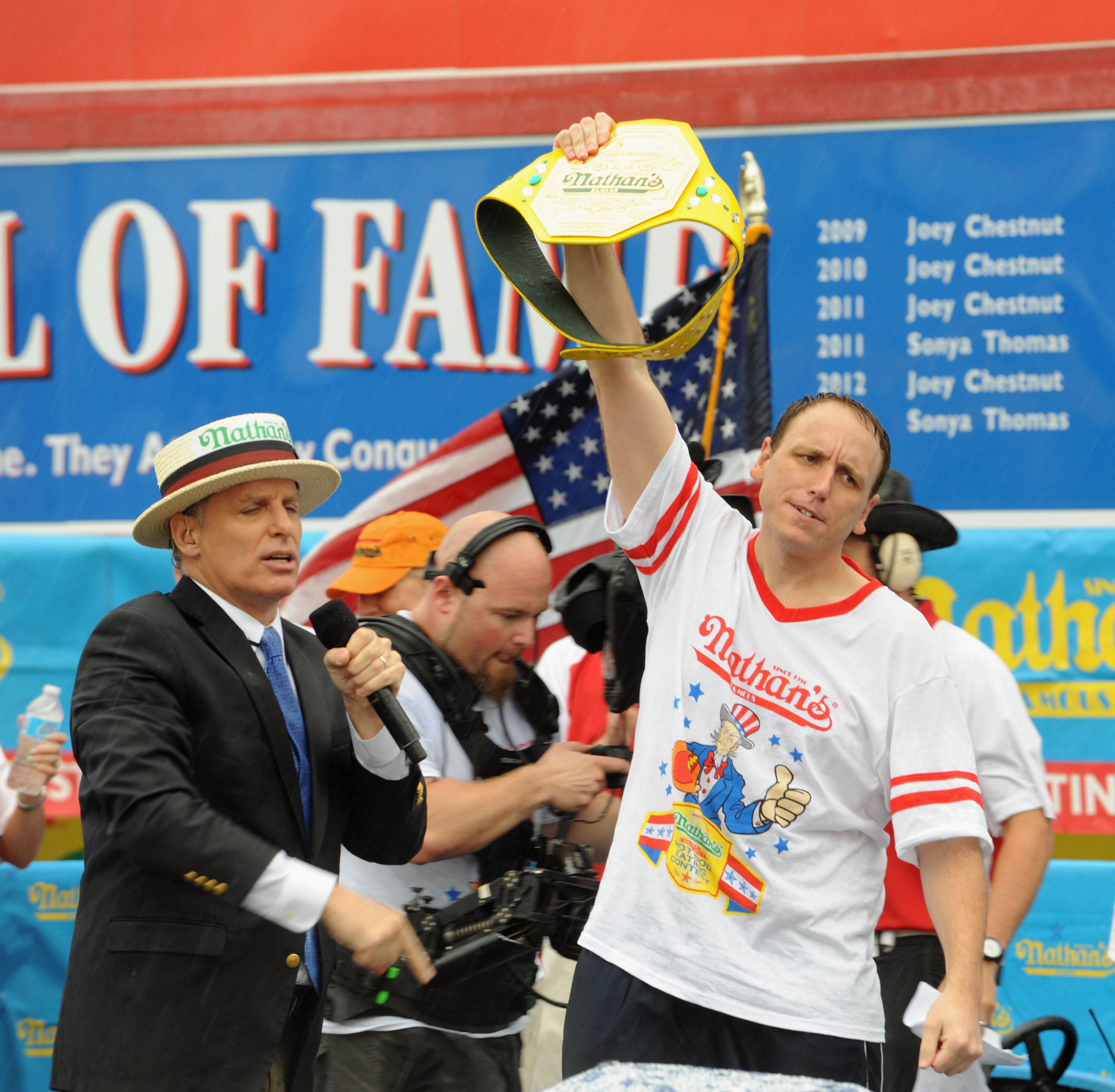 Joey Chestnut wins the Men's Division with 61 Hot Dogs at the 2014 Nathan's Famous 4th July International Hot Dog Eating Contest at Coney Island on July 4, 2014 in the Brooklyn borough of New York City.