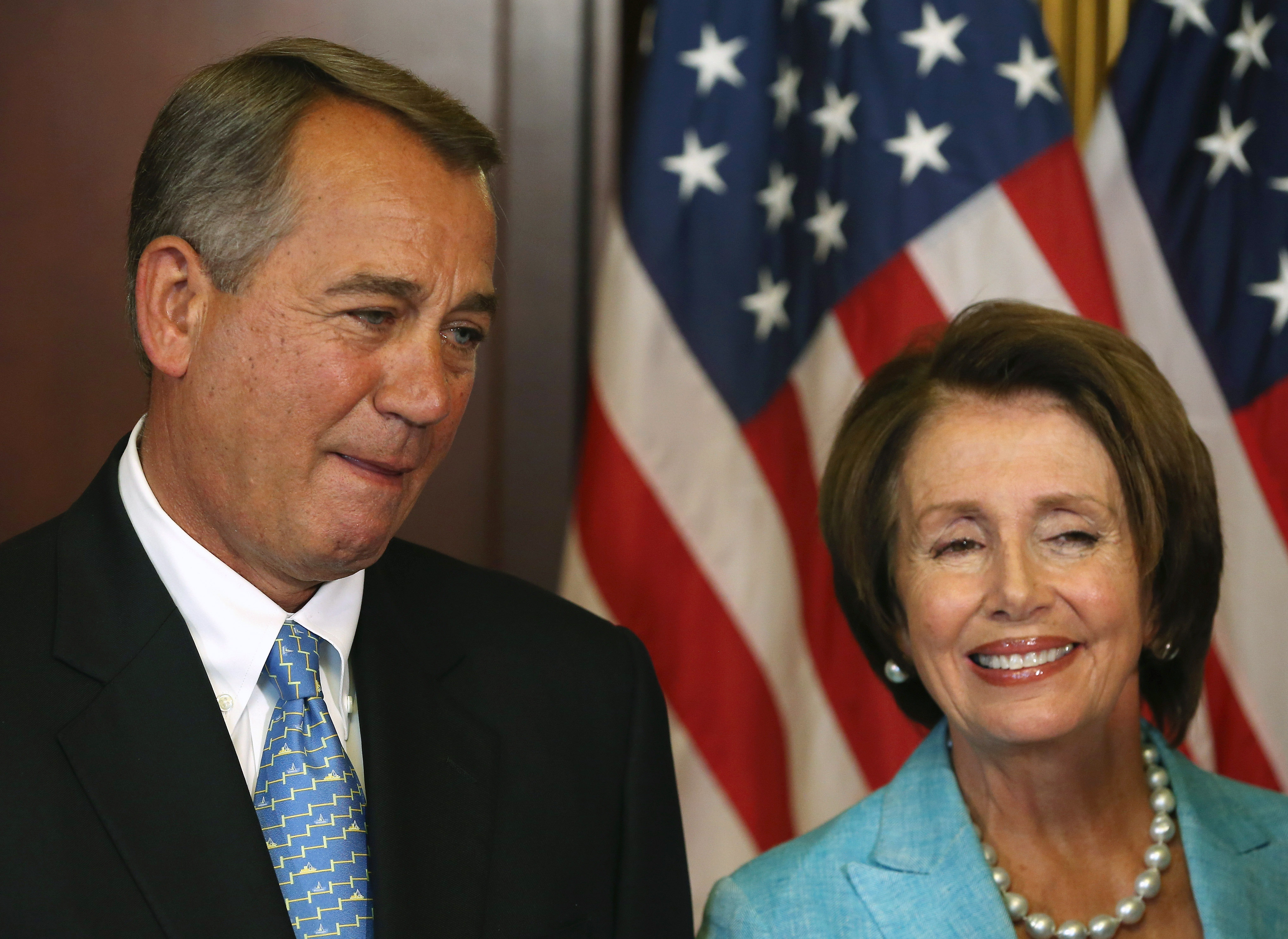 House Minority Leader Nancy Pelosi and House Speaker John Boehner await to sign bipartisan legislation Workforce Innovation and Opportunity Act at the U.S. Capitol, July 11, 2014 in Washington, DC.