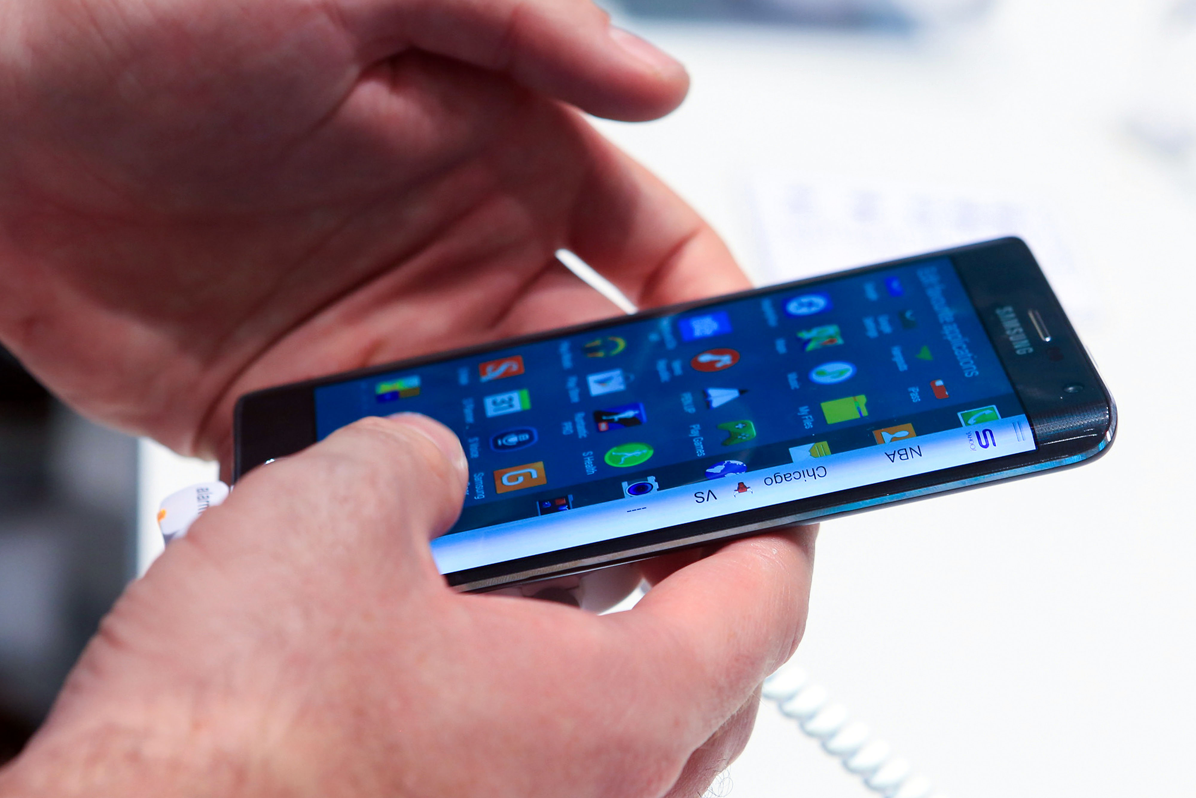 A visitor inspects a Samsung Galaxy Note Edge smartphone at the IFA Consumer Electronics Show in Berlin, Germany, on Friday, Sept. 5, 2014.