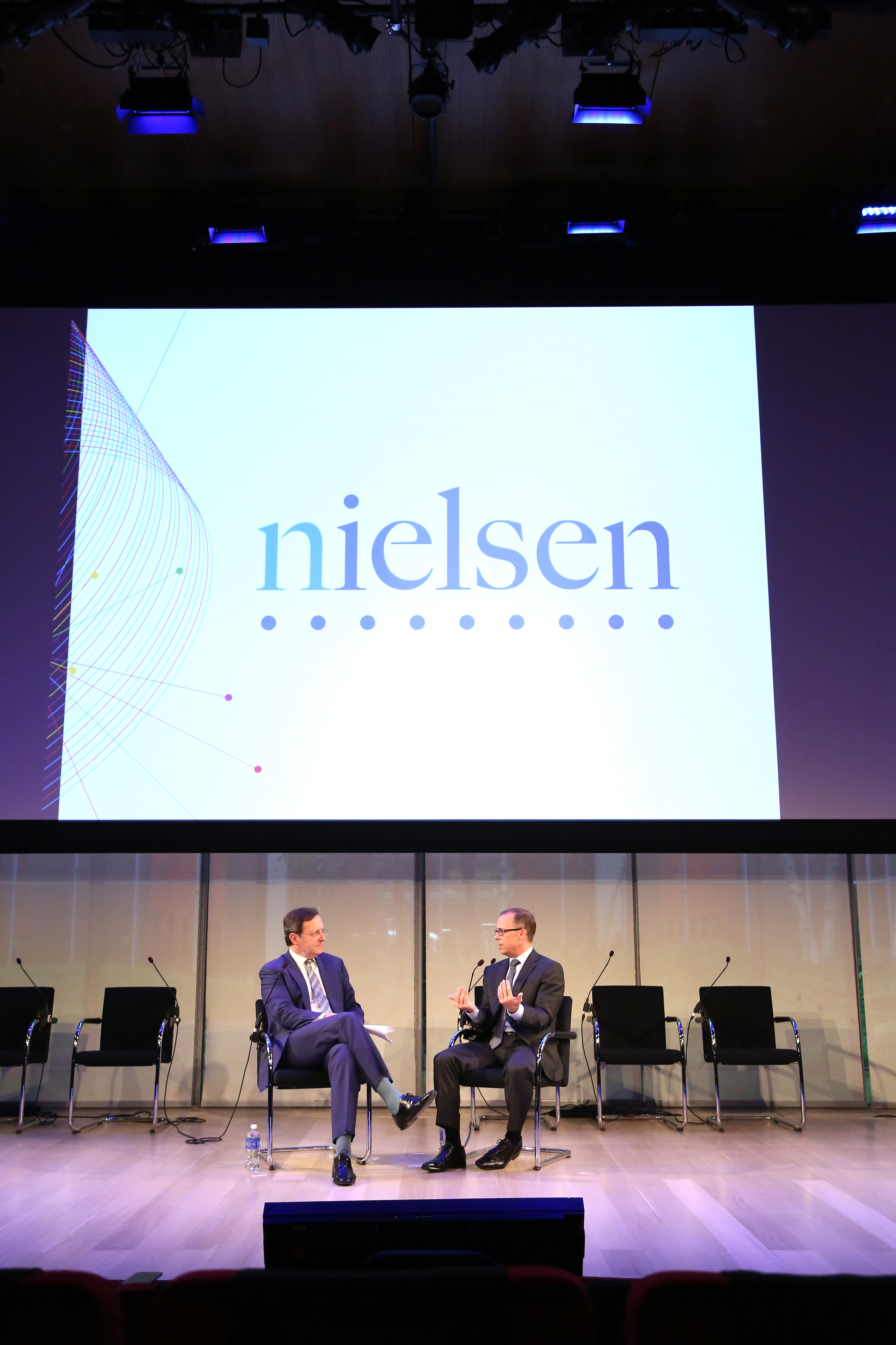 Senior Correspondent at CBS News, Anthony Mason (L) and CEO at Nielsen, Mitch Barns speak onstage at The Future of Measurement panel September 30, 2014 in New York City.