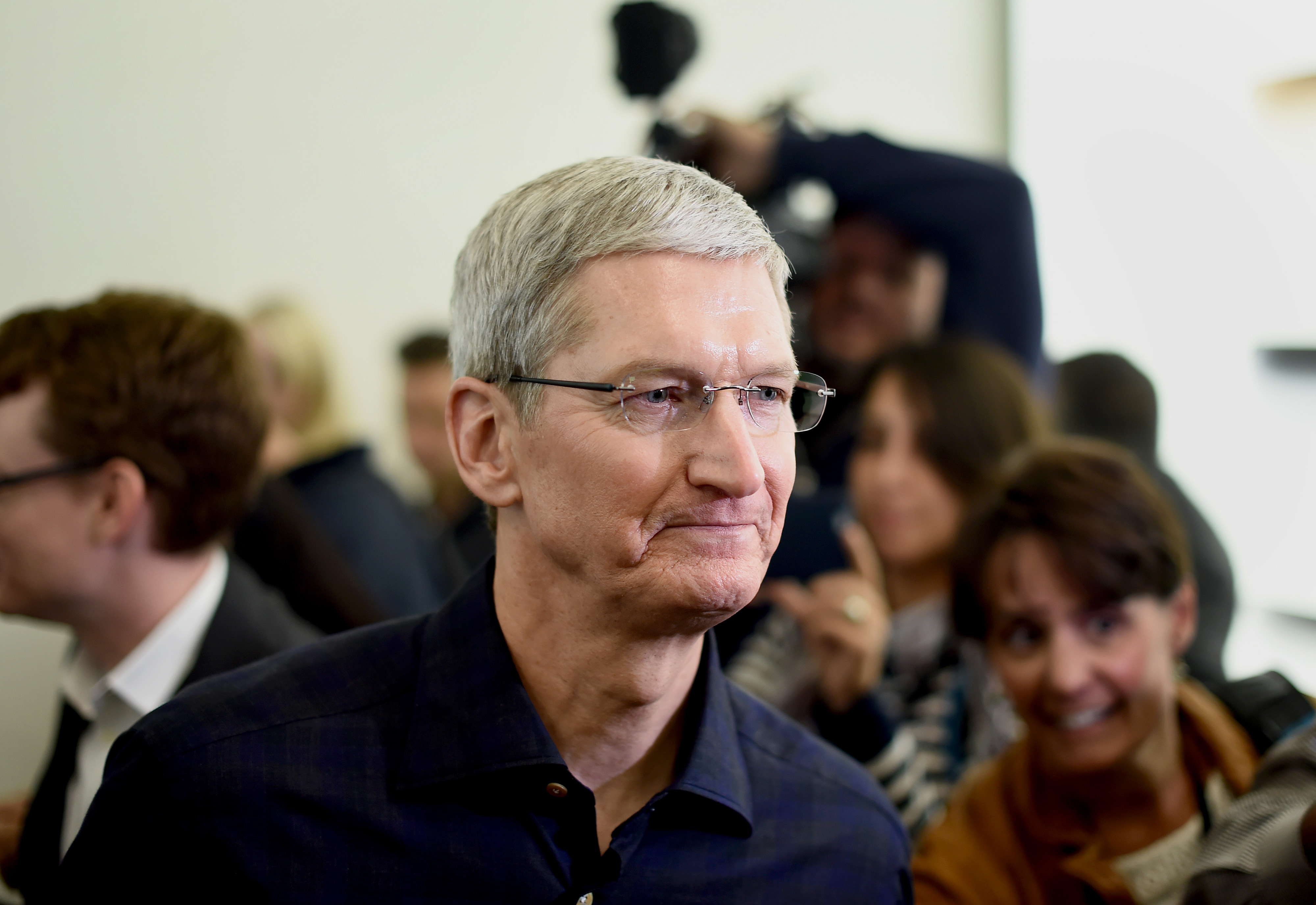Apple CEO Tim Cook speaks with members of the media after a product announcement in Cupertino, California, U.S., on Thursday, Oct. 16, 2014.