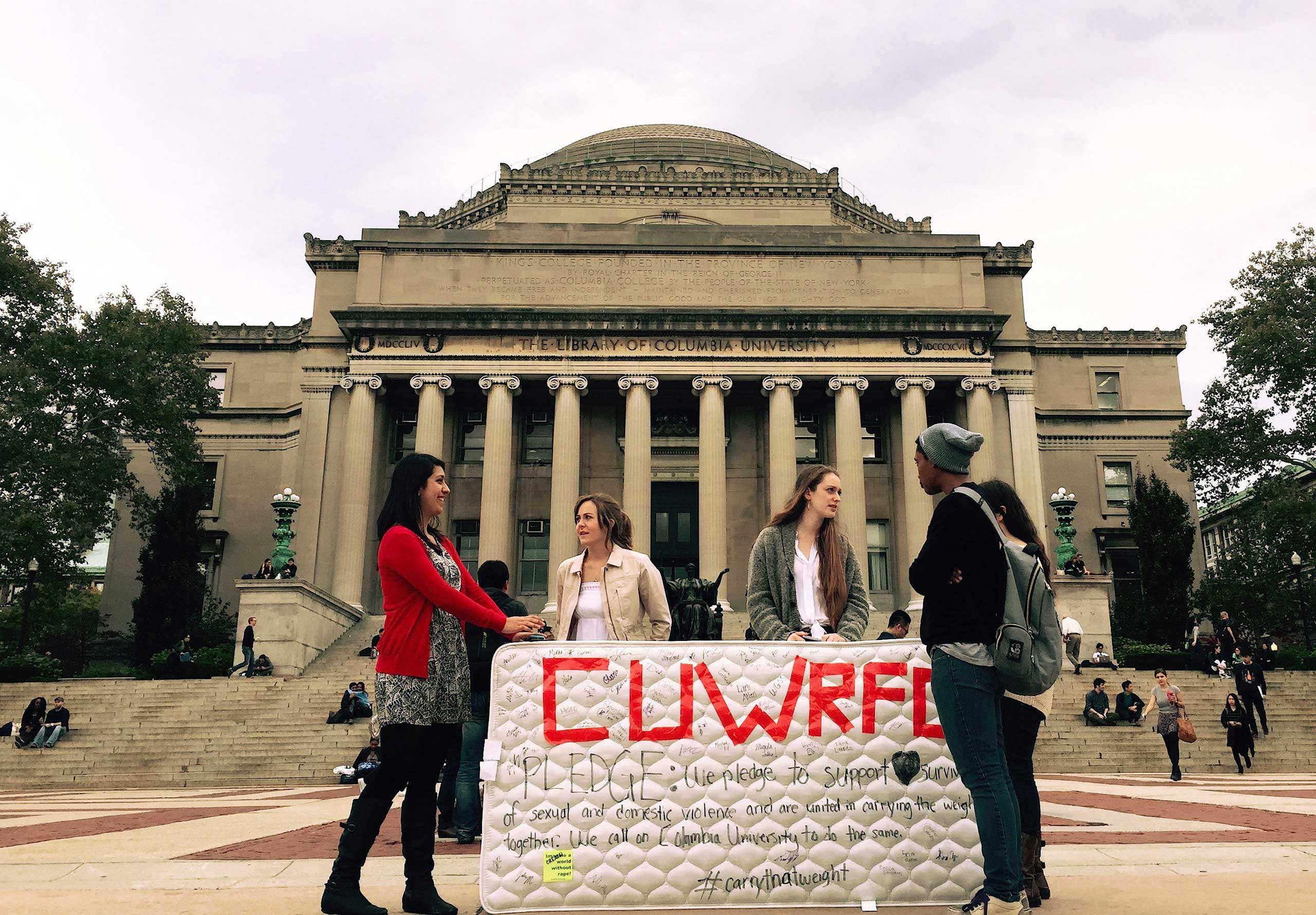 Student protesters stand in front of the Library of Columbia University, New York, Oct. 29, 2014.
