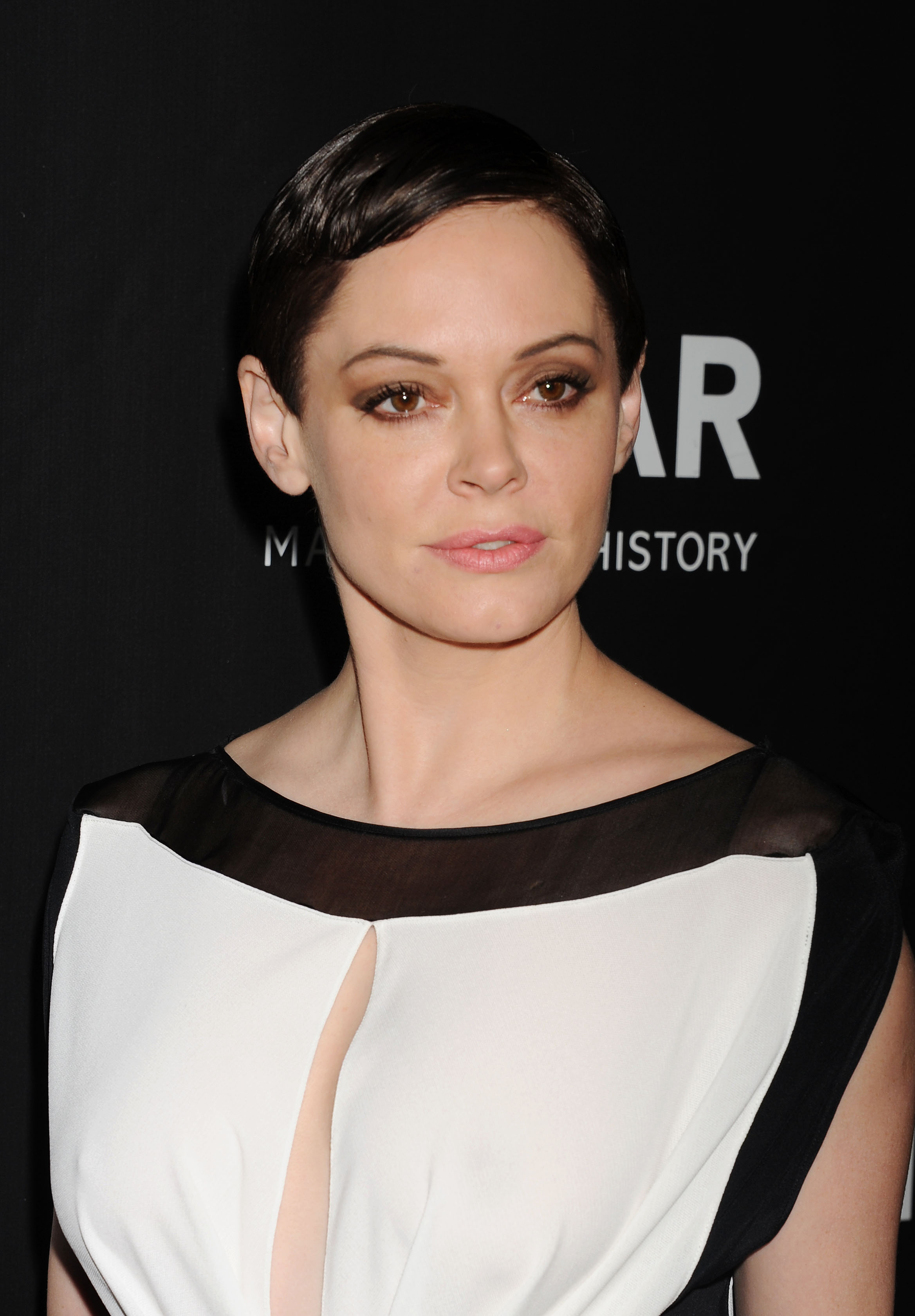 Actress Rose McGowan attends amfAR LA Inspiration Gala honoring Tom Ford at Milk Studios on October 29, 2014 in Hollywood, California.
