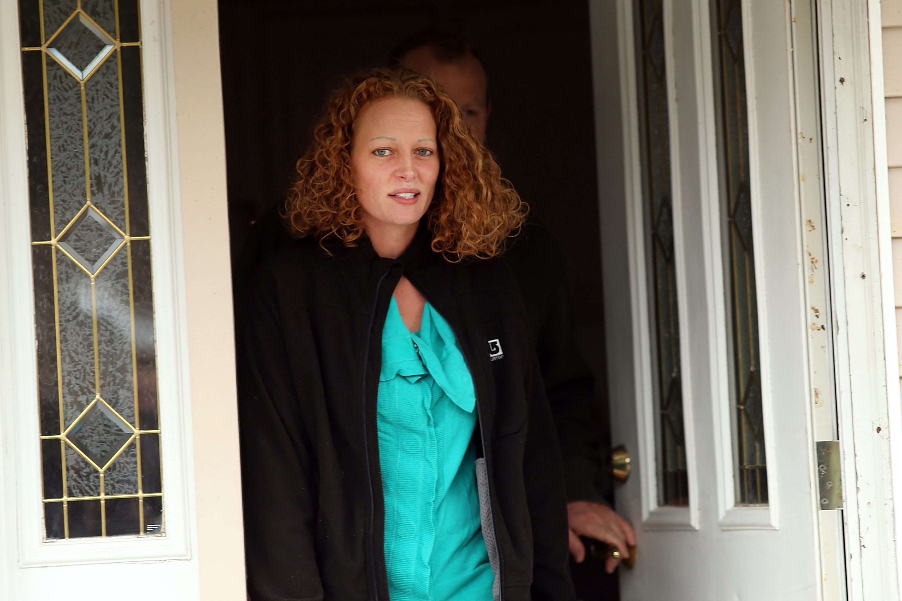 Kaci Hickox walks outside of her home to give a statement to the media on October 31, 2014 in Fort Kent, Maine.