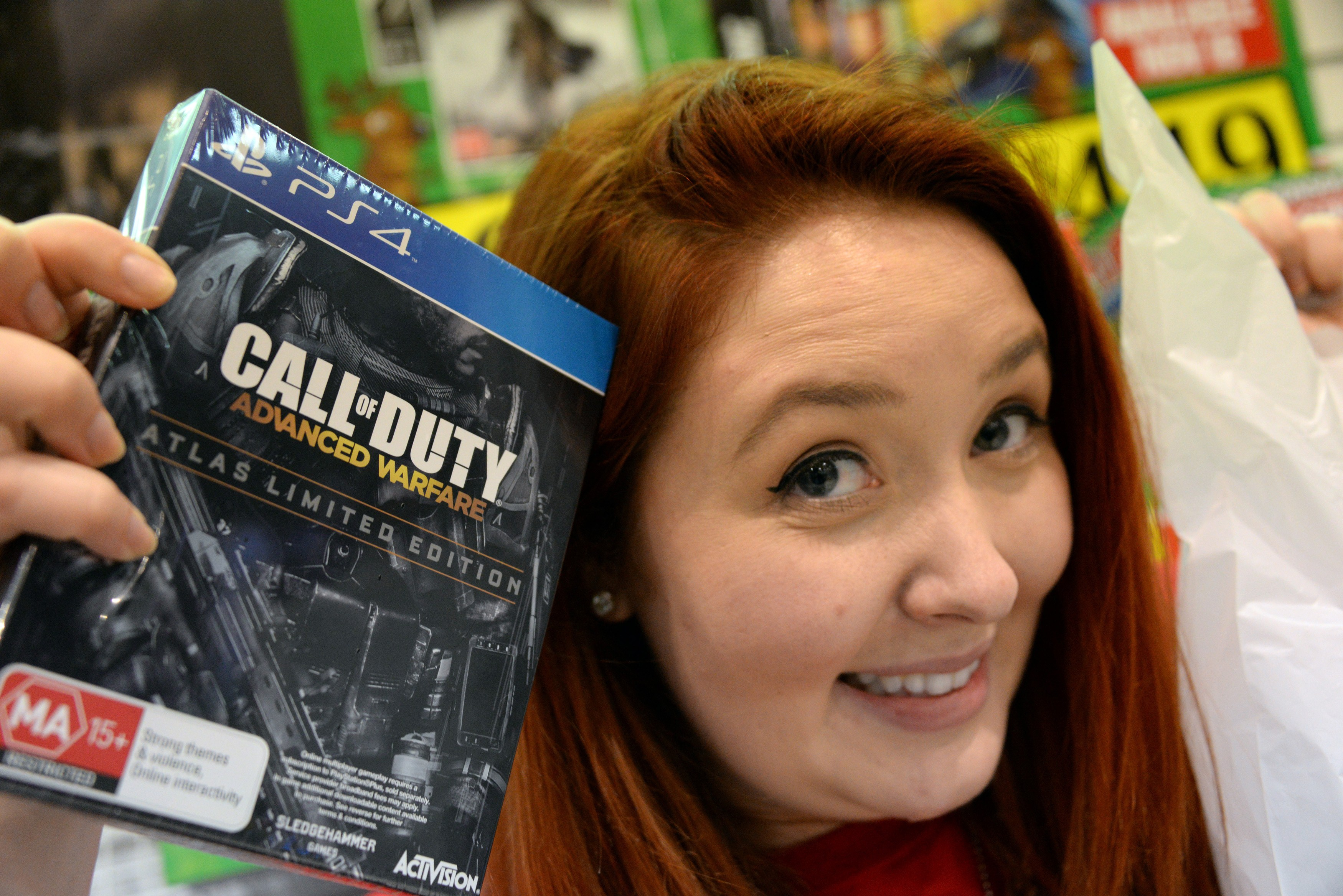 A shopper poses with the newest instalment of the  Call of Duty  videogame at a midnight launch of per-ordered copies of the game in Sydney on Nov. 3, 2014.