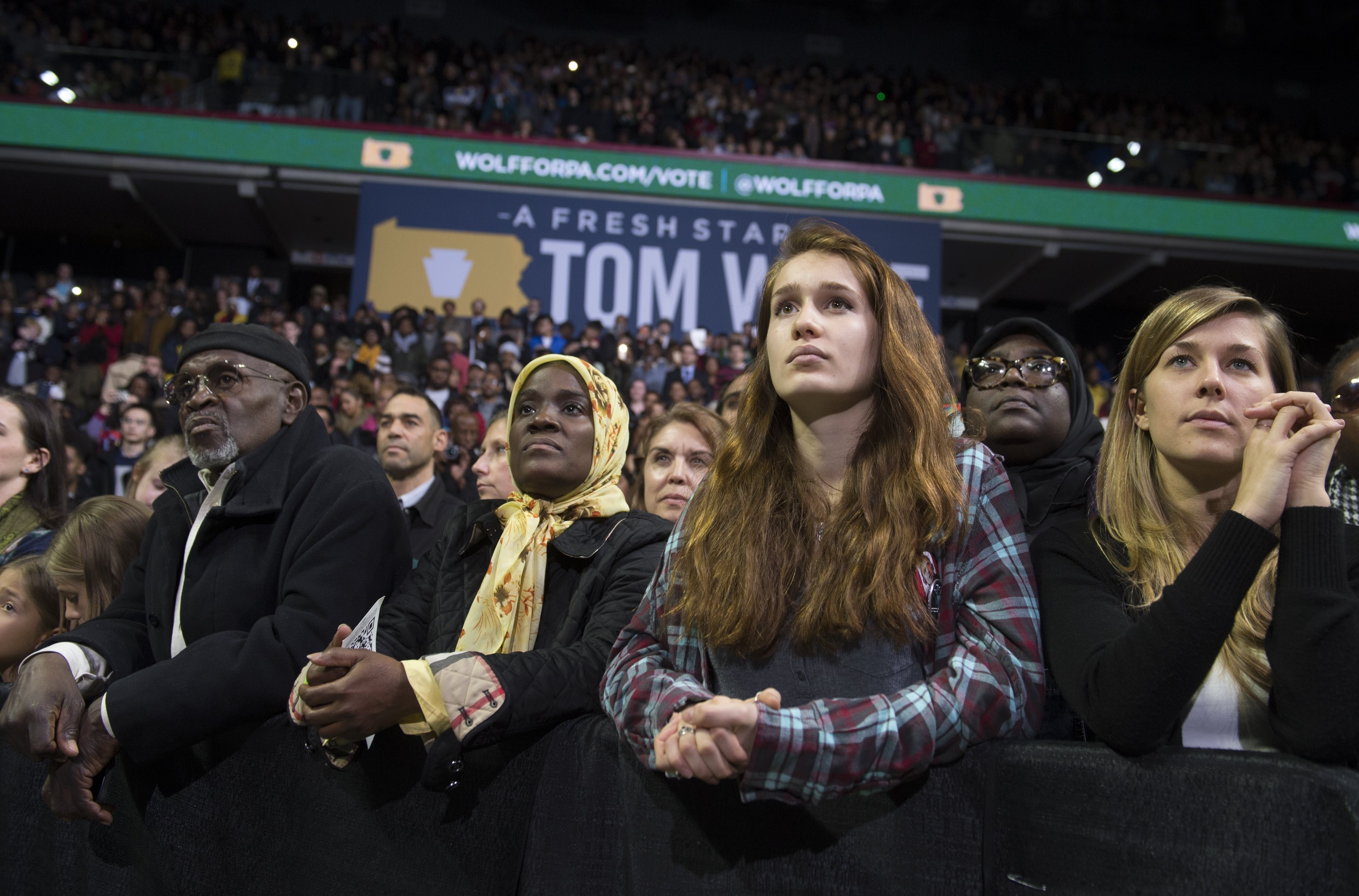 Supporters listen as US President Barack Obama speaks at a campaign rally for Tom Wolf, Democratic candidate for Pennsylvania Governor, at the Liacouras Center at Temple University in Philadelphia, Pennsylvania, November 2, 2014.