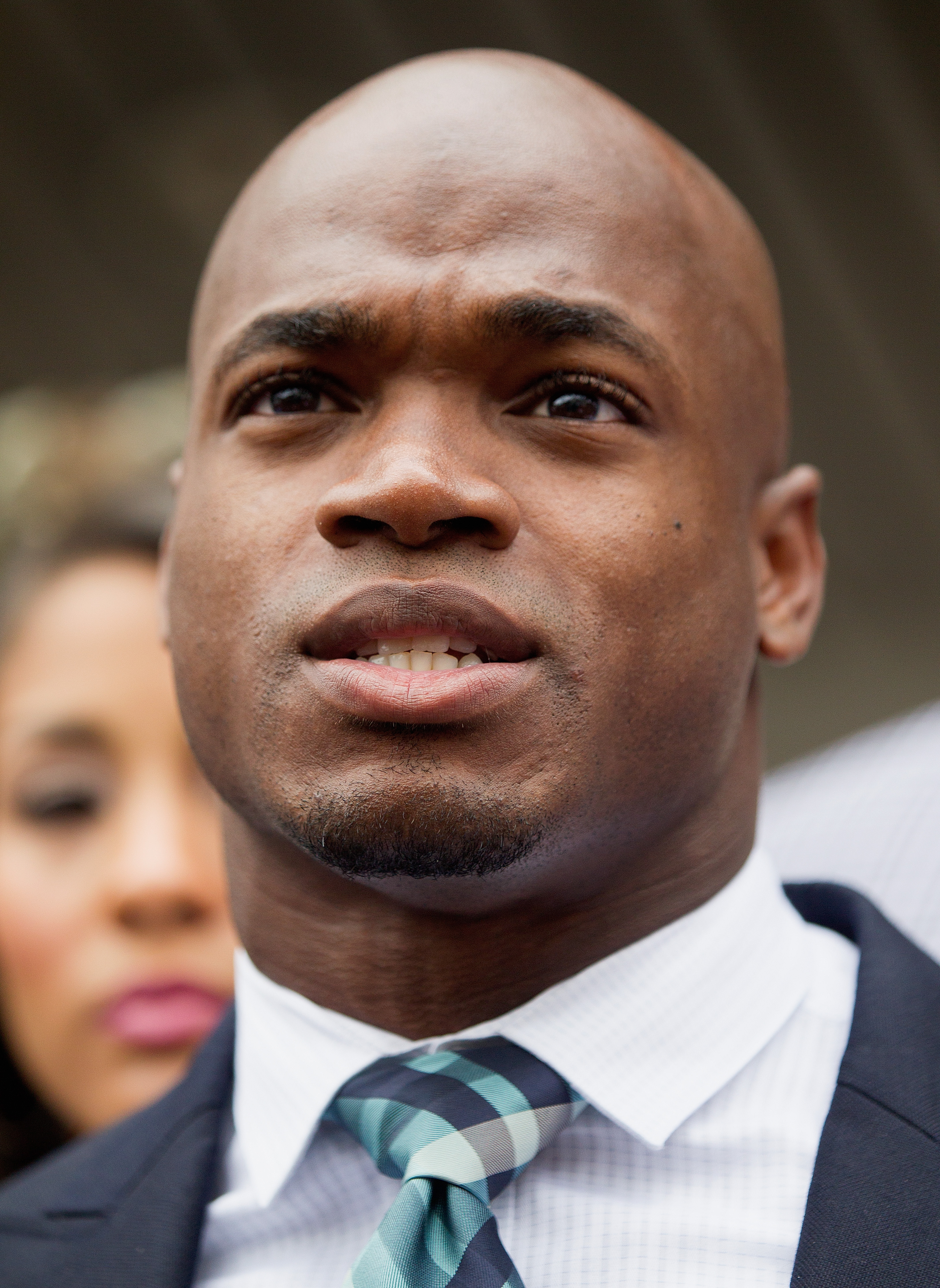 NFL running back Adrian Peterson of the Minnesota Vikings addresses the media after pleading  no contest  to a lesser misdemeanor charge of reckless assault Nov. 4, 2014 in Conroe, Texas.