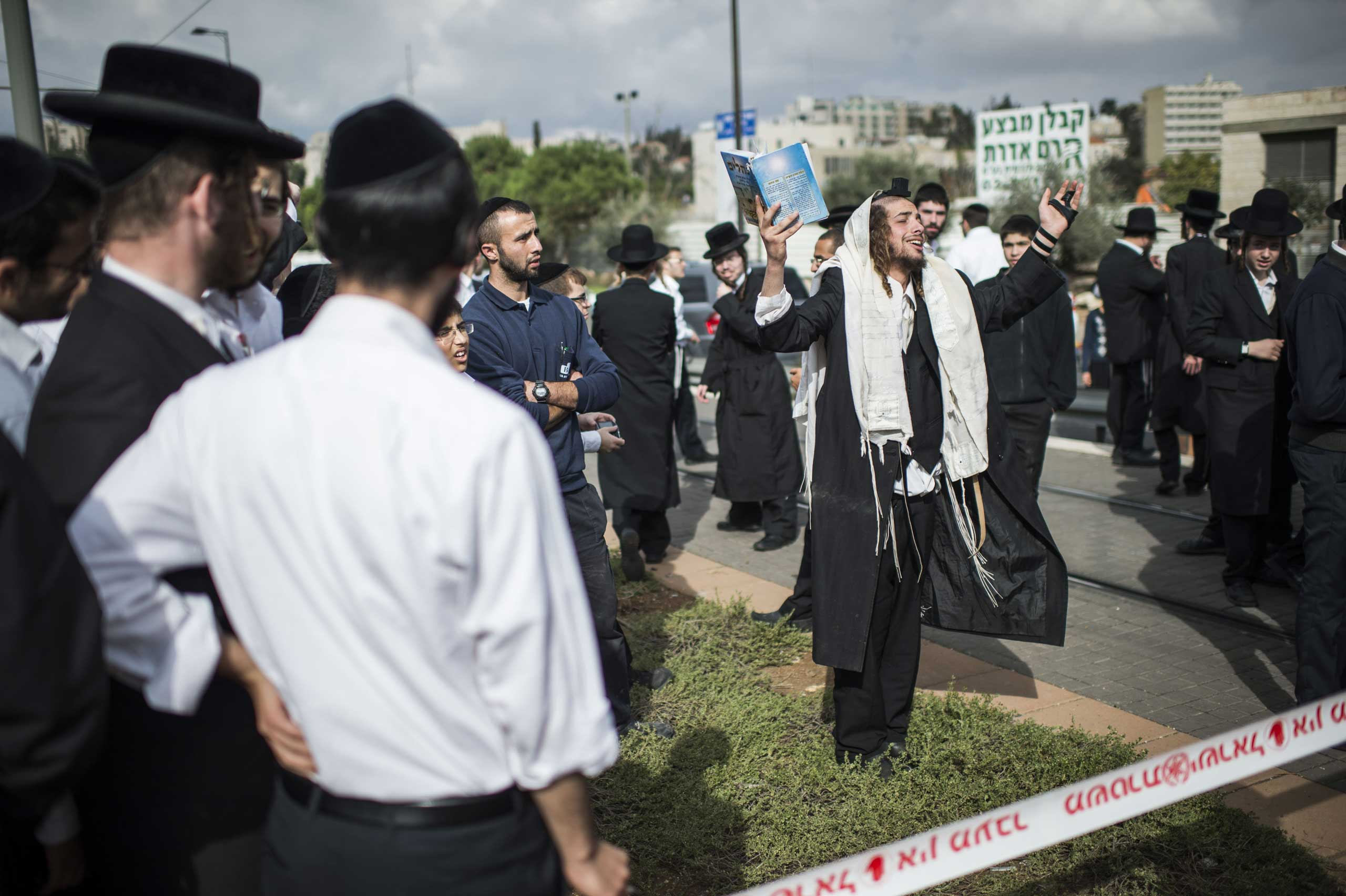 Nov. 5, 2014. Members of the Israeli Orthodox community at the scene of a suspected terrorist attack in Jerusalem. One person was killed and at least 13 people were wounded after a driver crashed into pedestrians in eastern Jerusalem on Wednesday.
