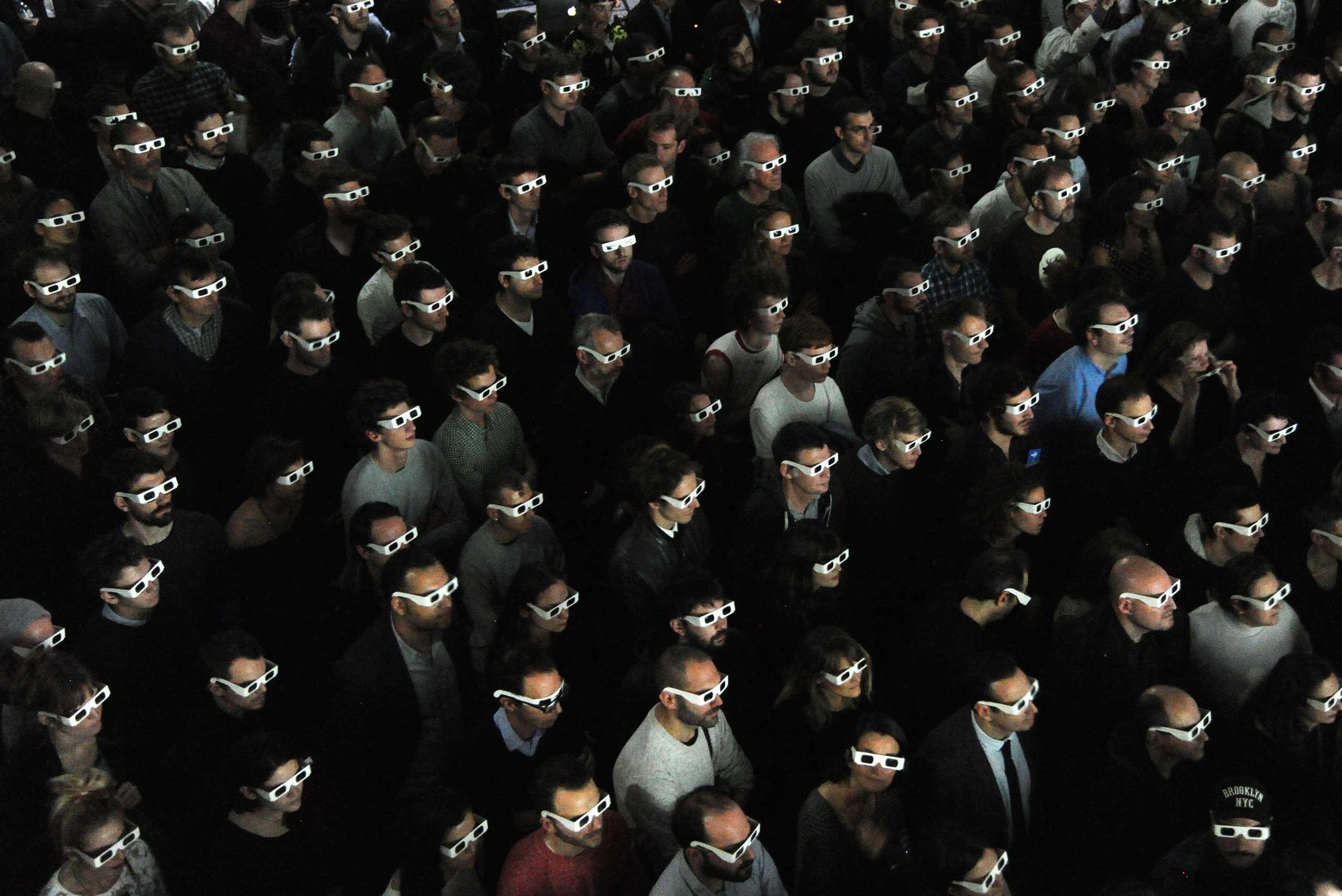 Nov. 6, 2014. Spectators wearing 3D glasses watch the live concert of the German band Kraftwerk at the Louis Vuitton Art Foundation in Paris.