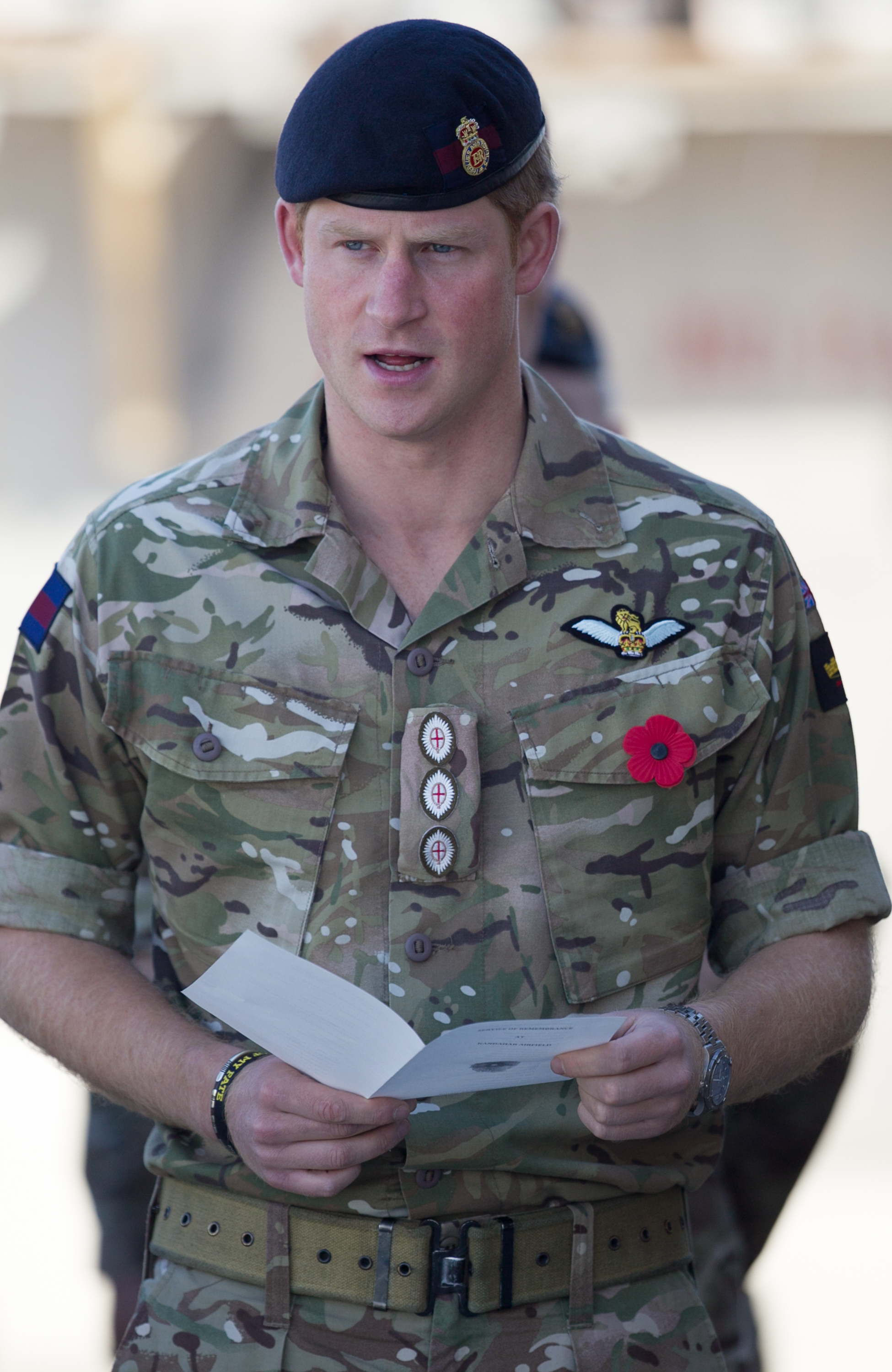 Prince Harry joins British troops and service personal remaining in Afghanistan and also International Security Assistance Force (ISAF) personnel and civilians as they gather for a Remembrance Sunday service at Kandahar Airfield November 9, 2014 in Kandahar, Afghanistan.