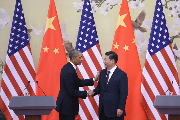 President Barack Obama shakes hands with Chinese President Xi Jinping after a joint press conference at the Great Hall of People in Beijing on Nov. 12, 2014.