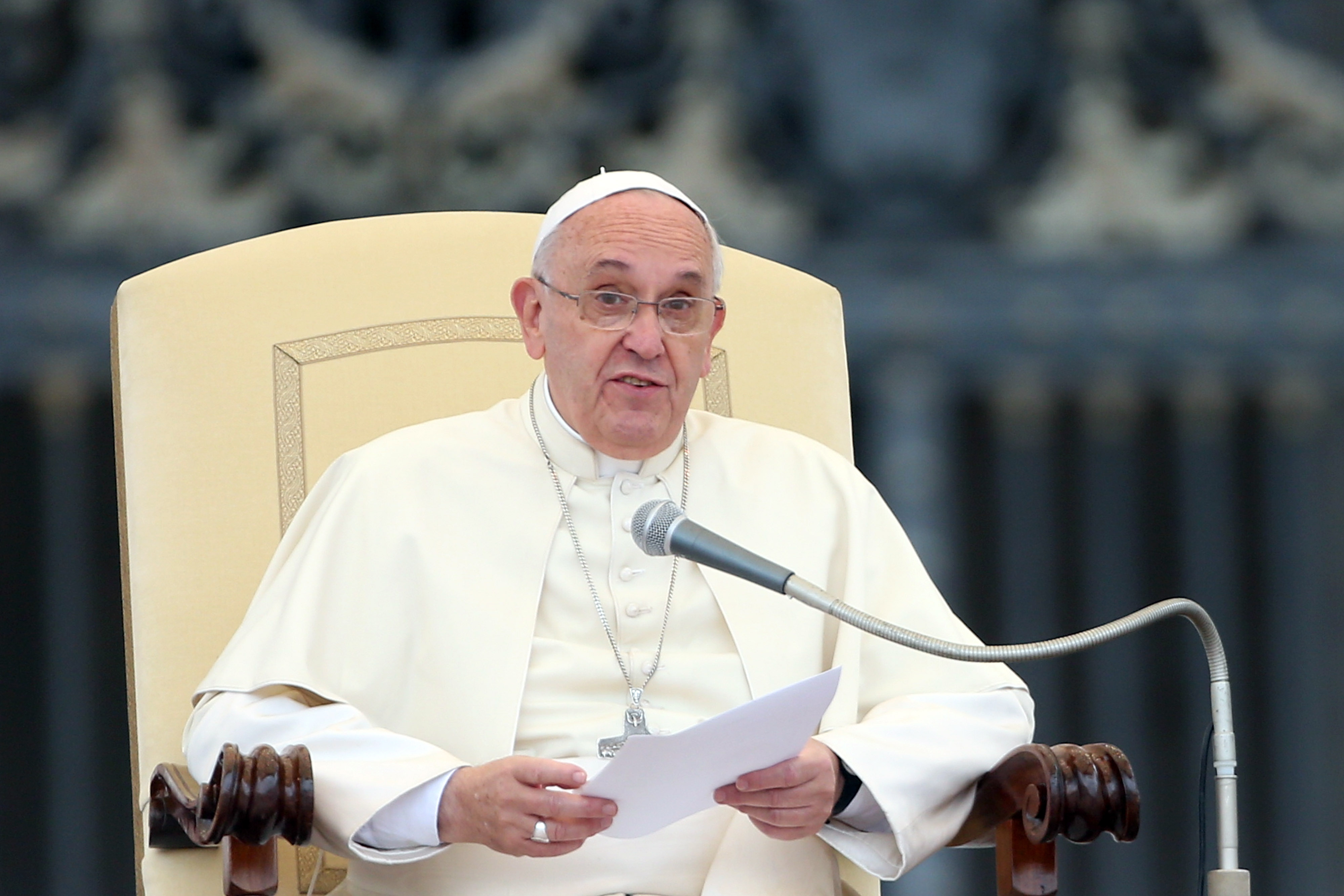 Pope Francis speaks during his weekly audience in St. Peter's square on November 12, 2014 in Vatican City, Vatican. During the event, the Pope asked the clergy to be humble, urging them to be understanding towards their communities and to avoid an authoritarian attitude.