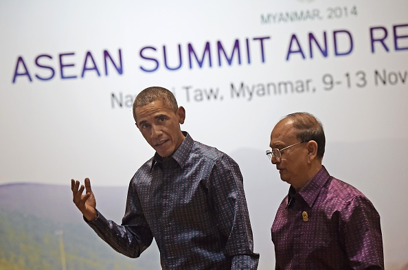 Burmese President Thein Sein, right, walks with U.S. President Barack Obama after the latter arrived at the Myanmar International Convention Center in the national capital Naypyidaw on Nov. 12, 2014