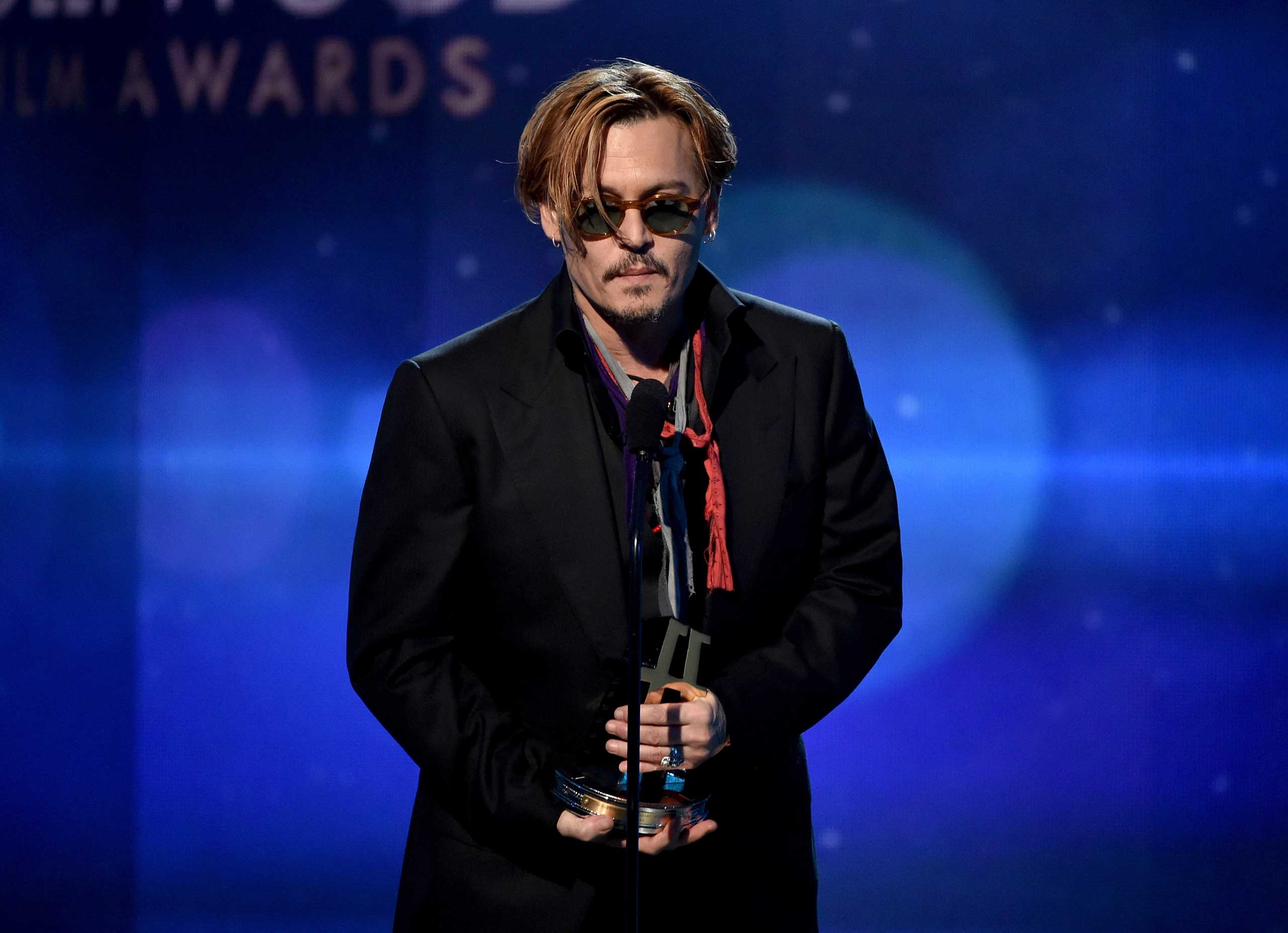 Johnny Depp speaks onstage during the 18th Annual Hollywood Film Awards at The Palladium on Nov. 14, 2014 in Hollywood.