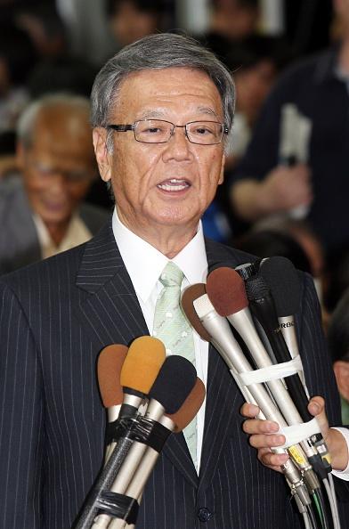 Former Naha mayor Takeshi Onaga speaks to reporters after winning the Okinawa gubernatorial election on Nov. 16, 2014, in Naha, the capital of Japan's Okinawa prefecture