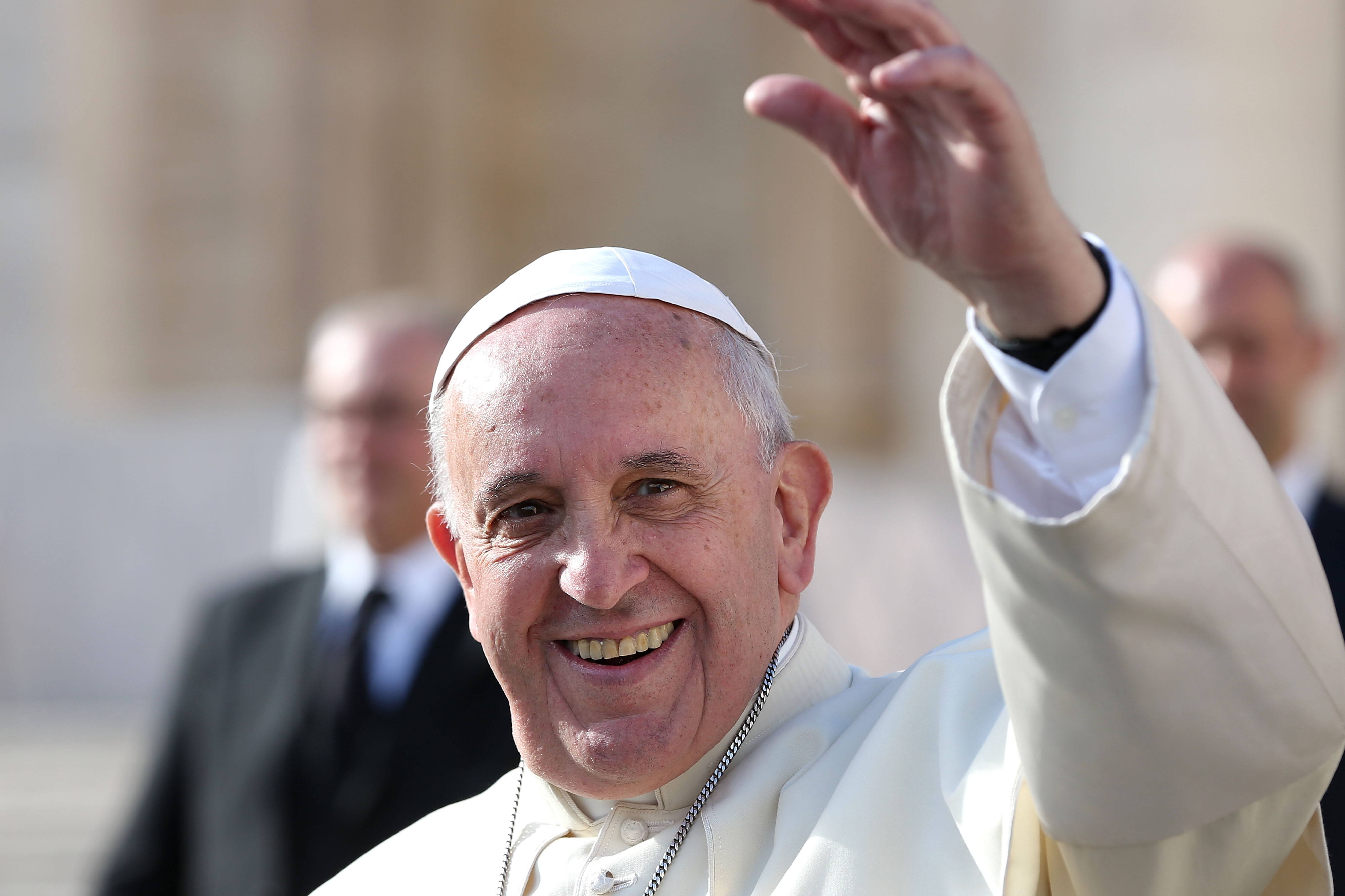 Pope Francis waves to the faithful as he leaves St. Peter's Square at the end of his weekly audience on Nov. 19, 2014, in Vatican City