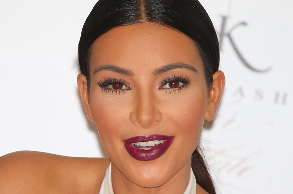 Kim Kardashian smiles as she promotes her new fragrance  Fleur Fatale  at Chadstone Shopping Centre on Nov. 19, 2014, in Melbourne, Australia