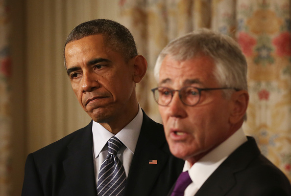 President Obama listens as Defense Secretary Chuck Hagel announces he is resigning after less than two years as defense chief.