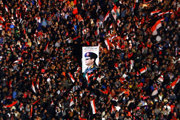 CAIRO, EGYPT - JANUARY 25: Egyptians supporting Abdel Fattah el-Sisi the Minister of Defense of Egypt gather at Tahrir square to mark the 3rd anniversary of Egyptian revolution which unseated autocrat president Hosni Mubarak in 2011, January 25, 2014. (Photo by Ahmed Ramadan/Anadolu Agency/Getty Images)