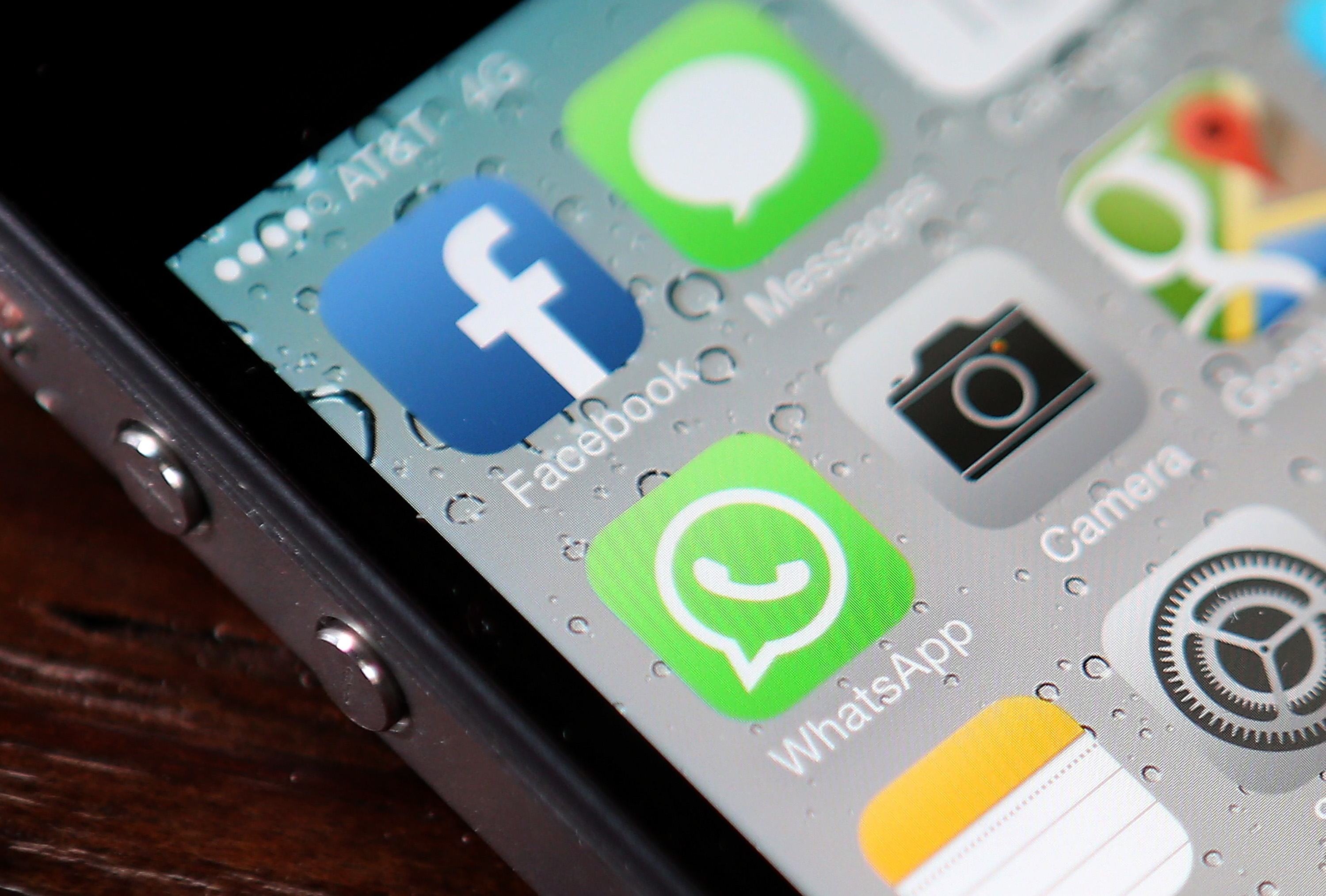 The Facebook and WhatsApp app icons are displayed on an iPhone on February 19, 2014 in San Francisco City.