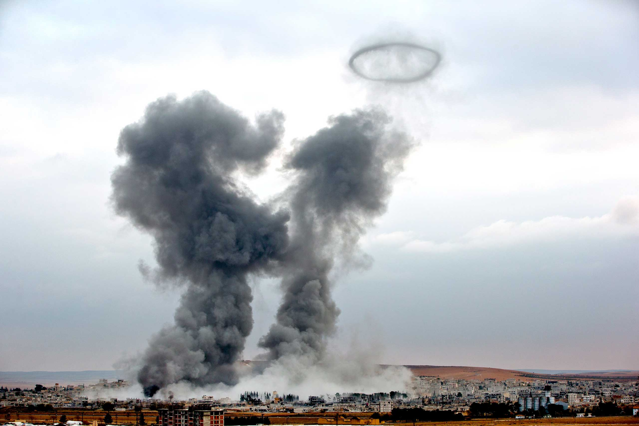 Nov. 17, 2014. Smoke rises from the Syrian city of Kobani, following airstrikes by the U.S.-led coalition, seen from a hilltop outside Suruc, on the Turkey-Syria border.