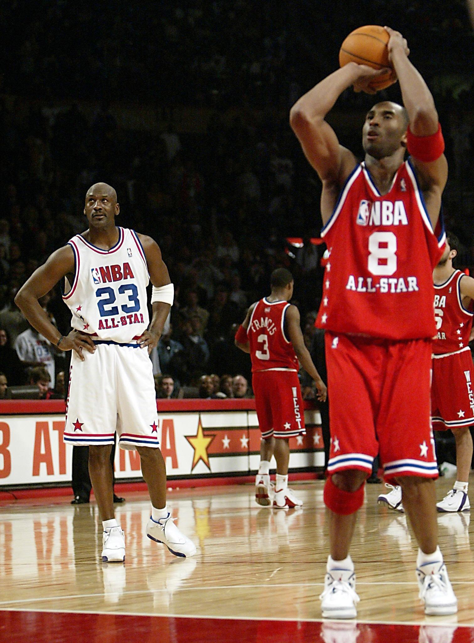 NBA All-Star Michael Jordan (L) of the Washington Wizards watches Kobe Bryant (R) of the Los Angeles Lakers miss his second free throw that would have ended the NBA All-Star game at Philips Arena on February 9, 2003 in Atlanta, Georgia.