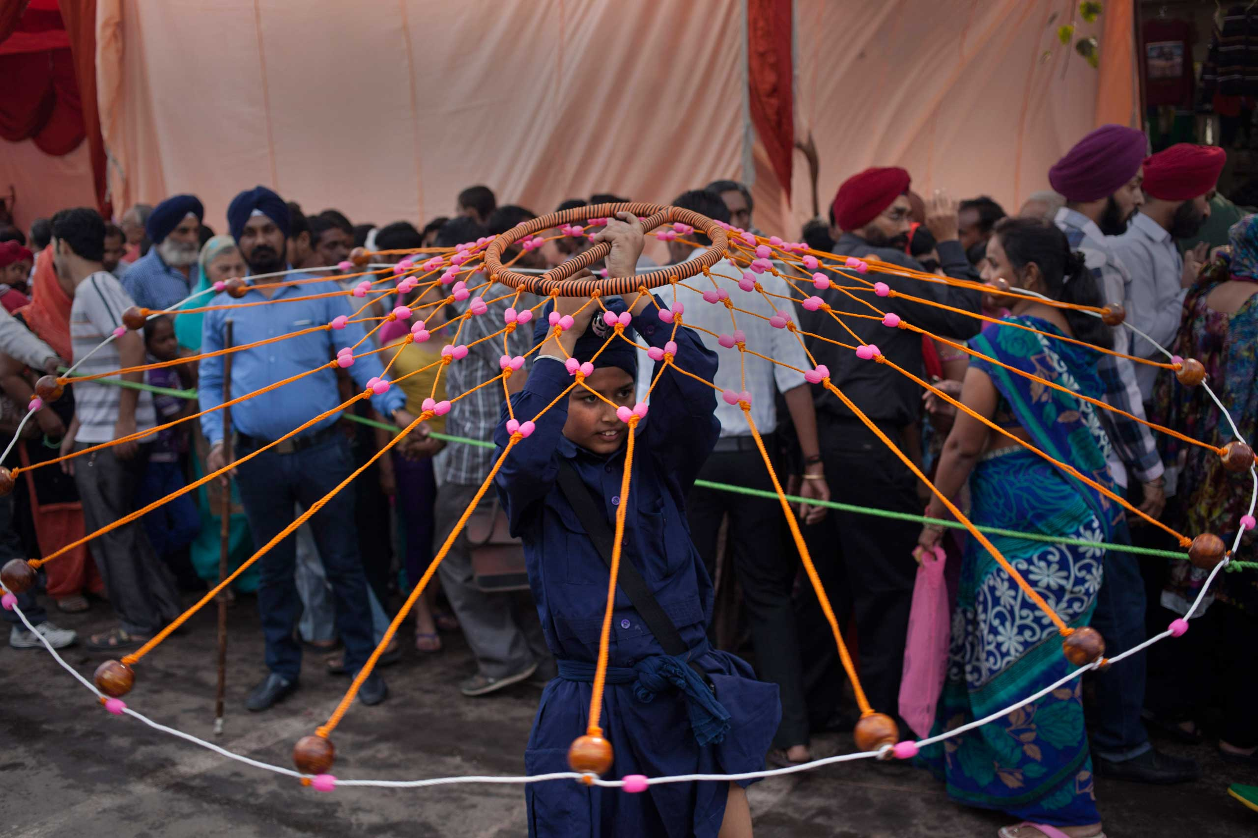 Nov. 5, 2014. An Indian Sikh boy displays his martial art skills during a religious procession on the eve of the birth anniversary of Guru Nanak, the first Sikh Guru, in New Delhi.