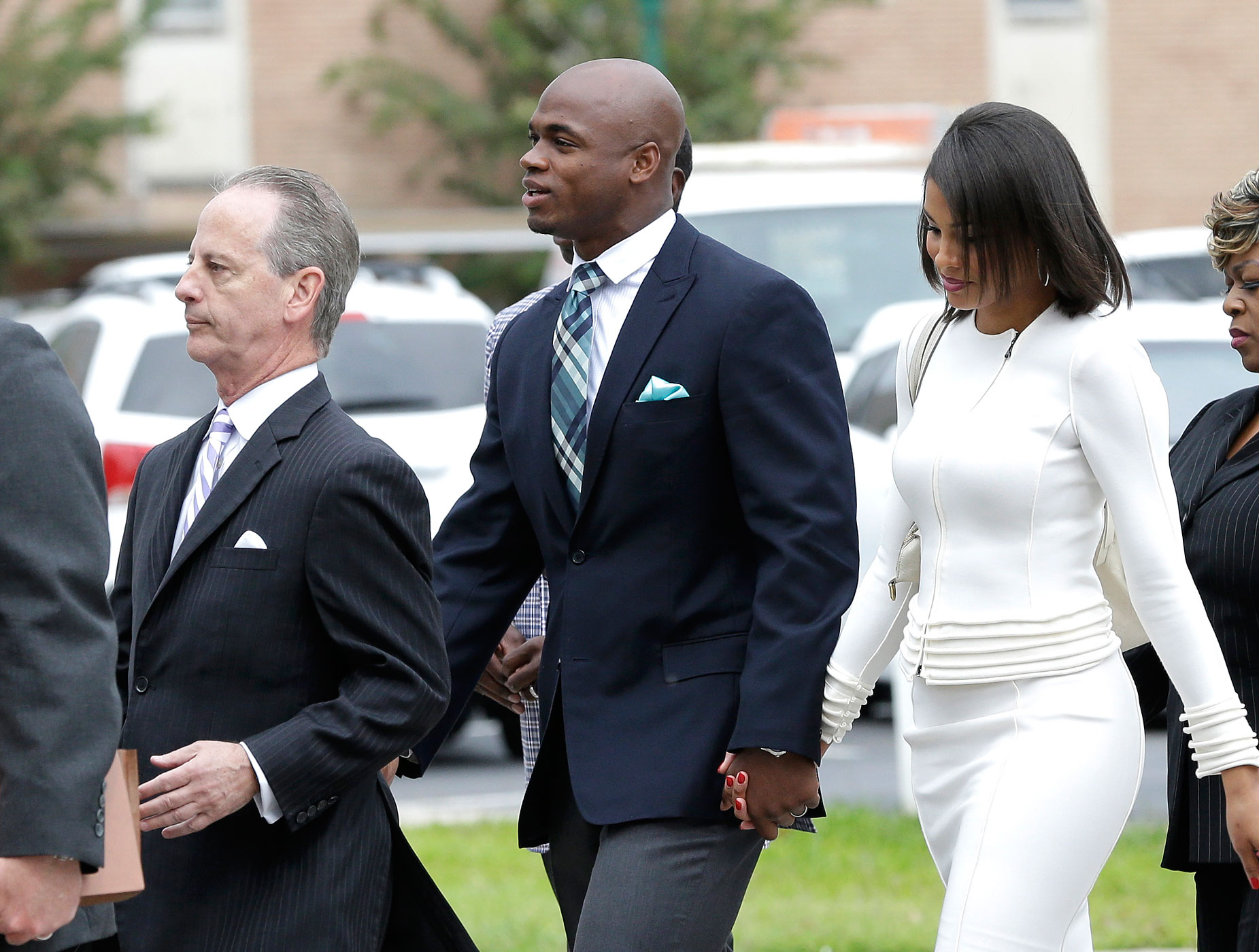 Minnesota Vikings running back Adrian Peterson, center, arrives at the courthouse with his wife Ashley Brown Peterson, right, and attorney Brian Wice, Nov. 4, 2014, in Conroe, Texas.