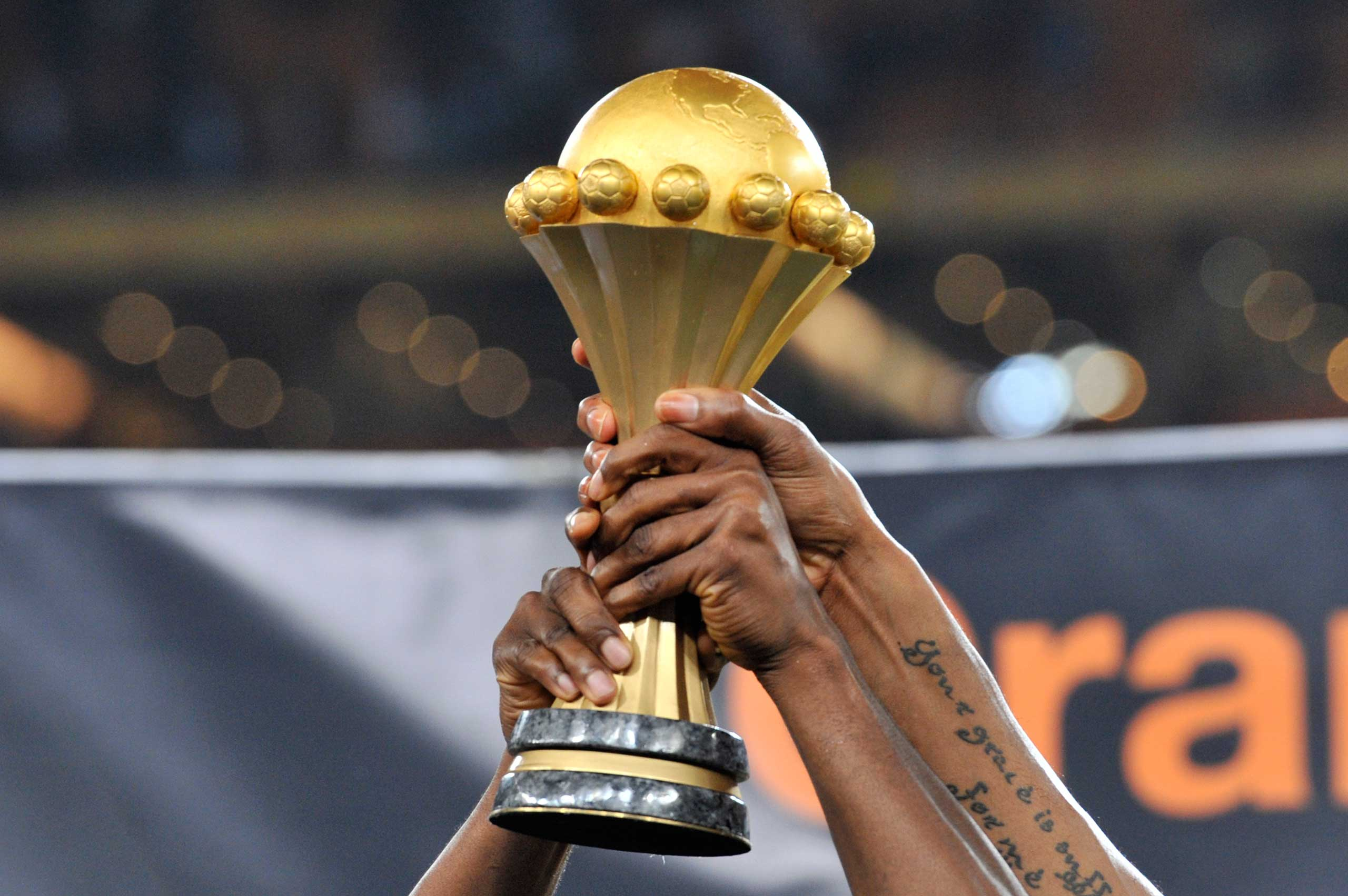 Nigeria's national football team players hold the trophy as they celebrate winning the 2013 African Cup of Nations final against Burkina Faso on Feb. 10, 2013 at Soccer City stadium in Johannesburg.