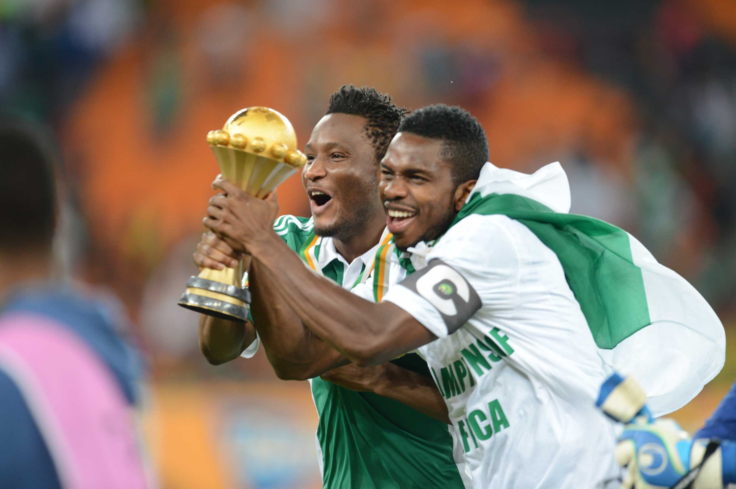 John Obi Mikel celebrates holding the trophy during the 2013 Orange African Cup of Nations Final match between Nigeria and Burkina Faso from the National Stadium in Johannesburg on Feb. 10, 2013.