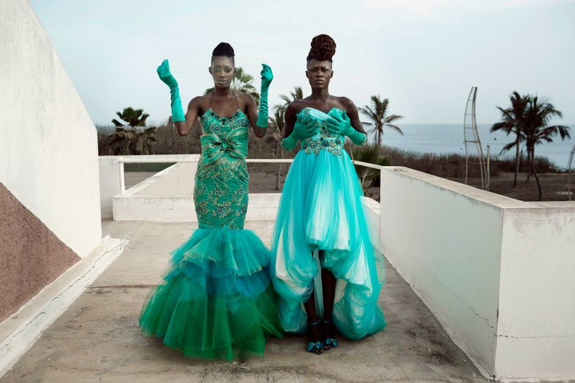 Models fit dresses for the Cameroonian, Paris- based, designer Martial Tapolo Couture before a show at Dakar Fashion Week on June 20, 2014, at Hotel des Almadies in Dakar, Senegal.