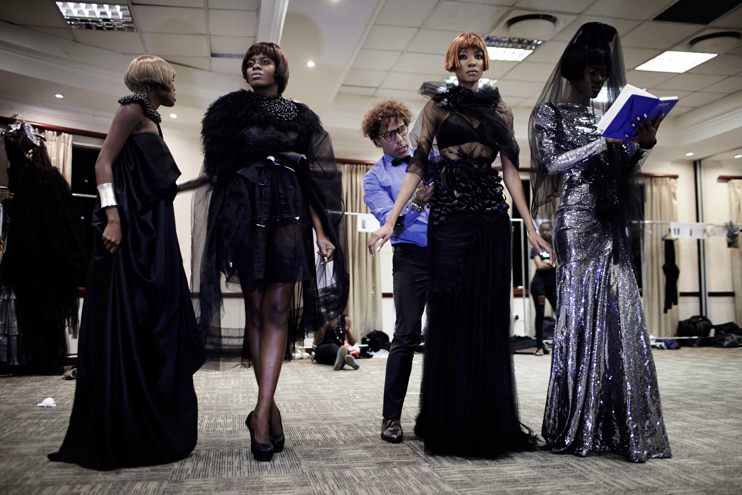 Egyptian designer Soucha prepares his models backstage before his fashion show at Color in the Desert Fashion week on Sept. 1, 2012 in Gaborone, Botswana.