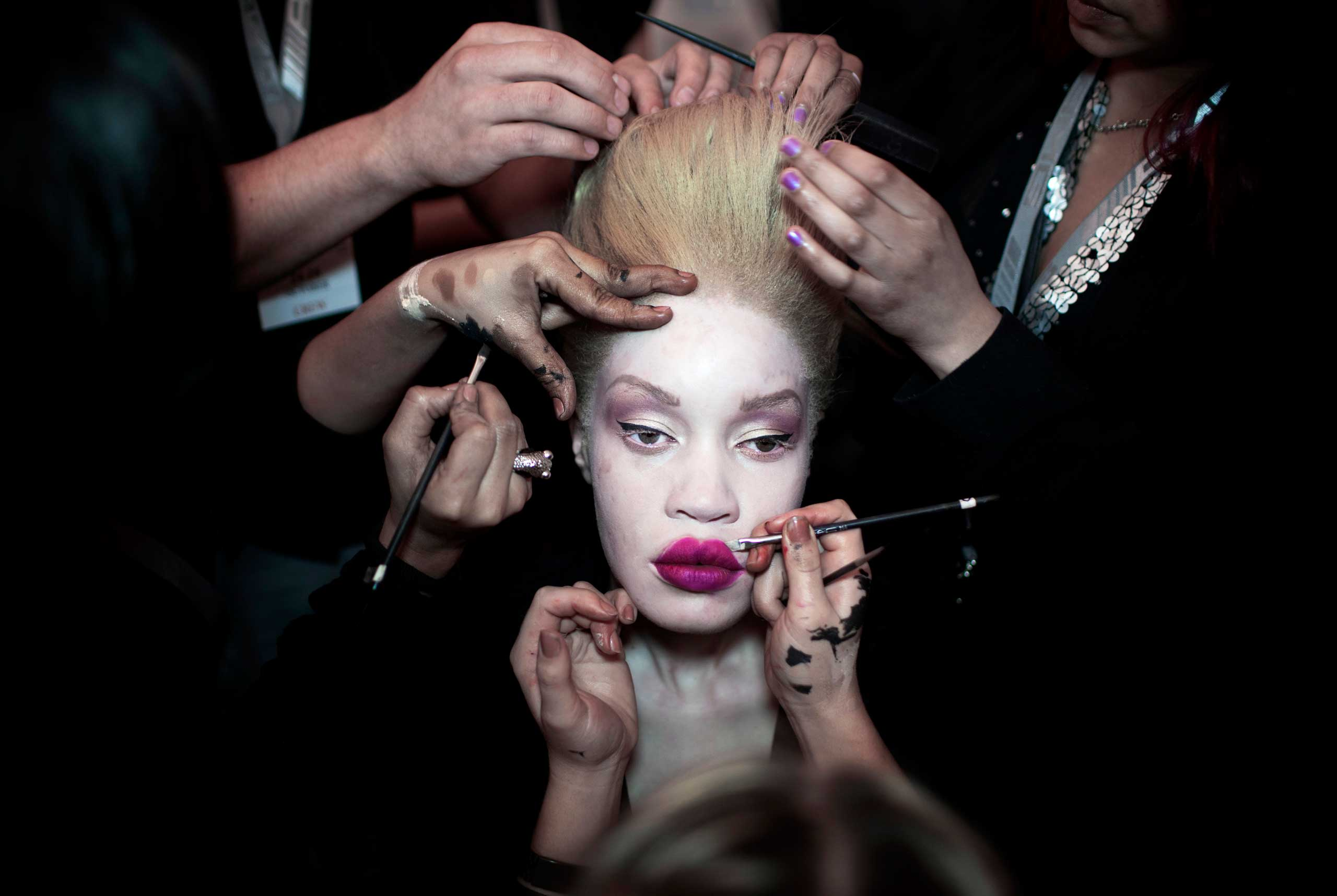 A fashion model has her makeup and hair done backstage before a show at Mercedes Benz Africa fashion week on Oct. 25, 2012 held in Johannesburg, South Africa.