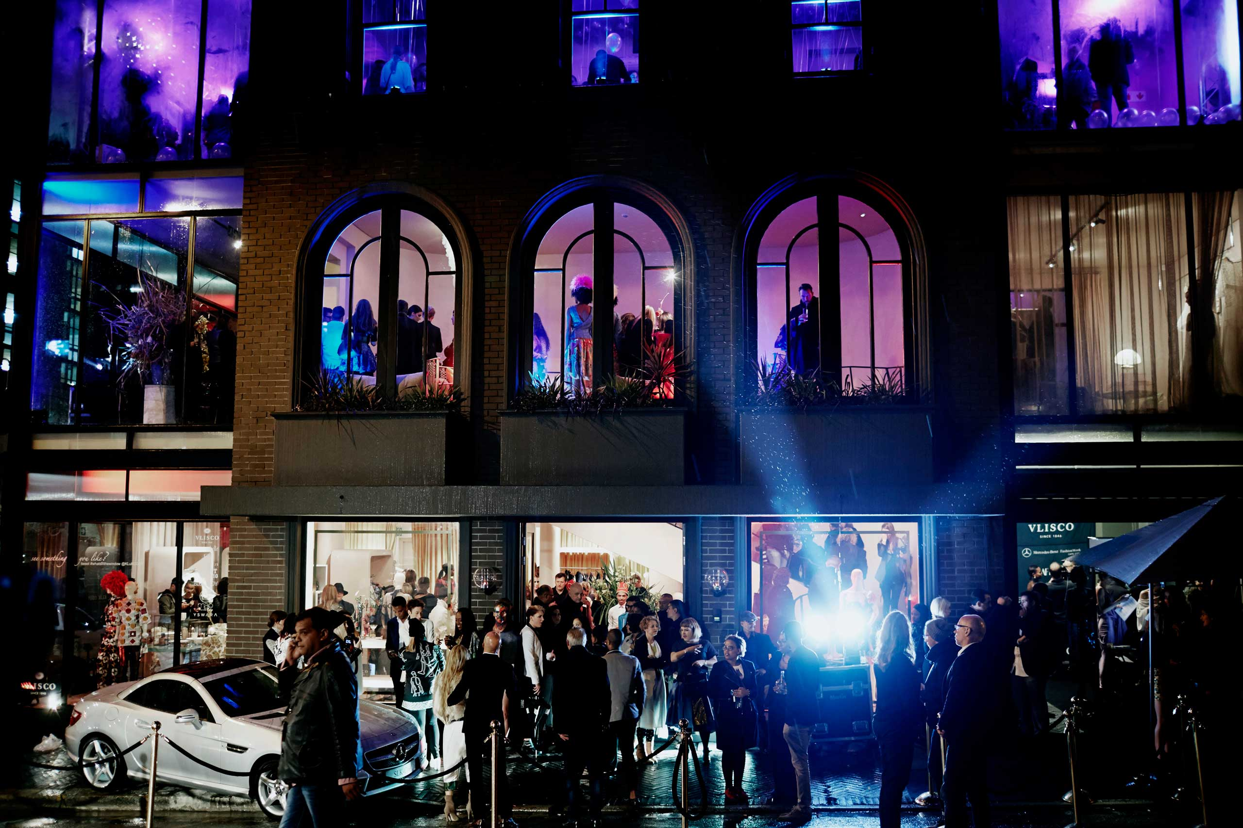 Guests arrive during an installation show at the new Klûk CGDT flagship store during Mercedes-Benz Fashion Week on July 26, 2014, in Cape Town, South Africa.