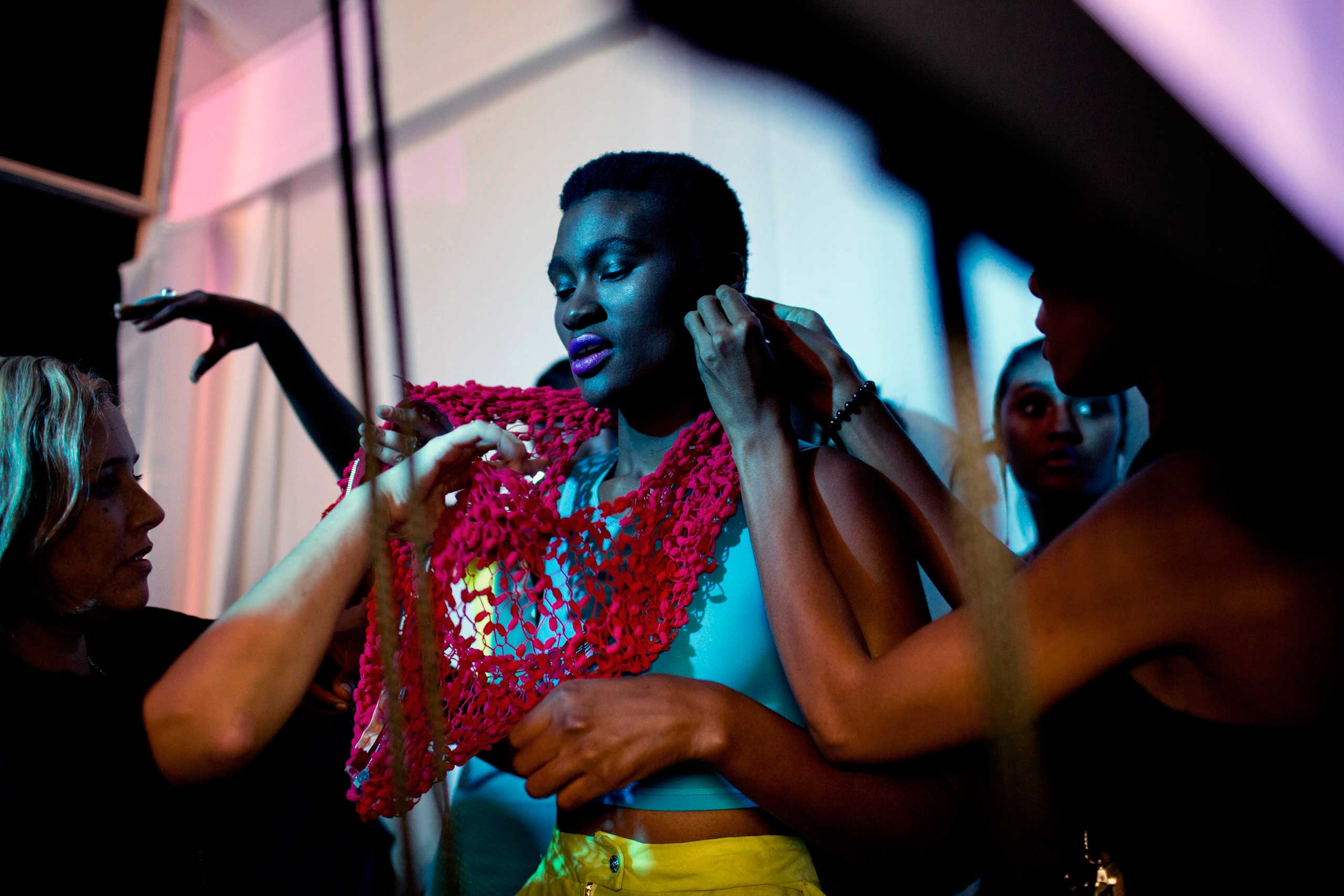 Models walking for the Zimbabwean designer label Intisaar waits backstage before a show at Mercedes Benz Africa fashion week Africa on Oct. 29, 2014 held at Melrose Arch in Johannesburg, South Africa.