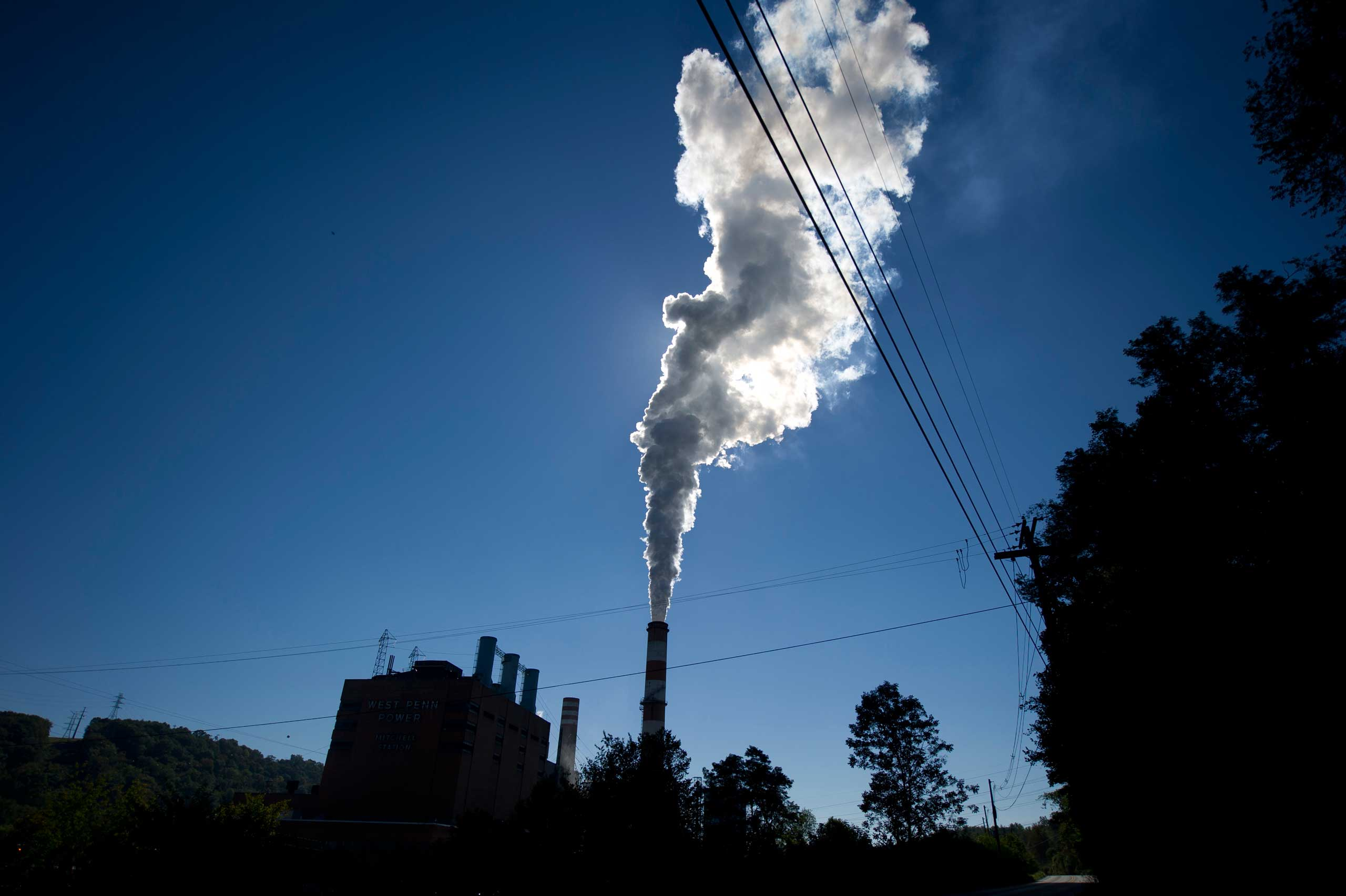 A plume of exhaust extends from the Mitchell Power Station, a coal-fired power plant located 20 miles southwest of Pittsburgh, on Sept. 24, 2013 in New Eagle, Pa.
