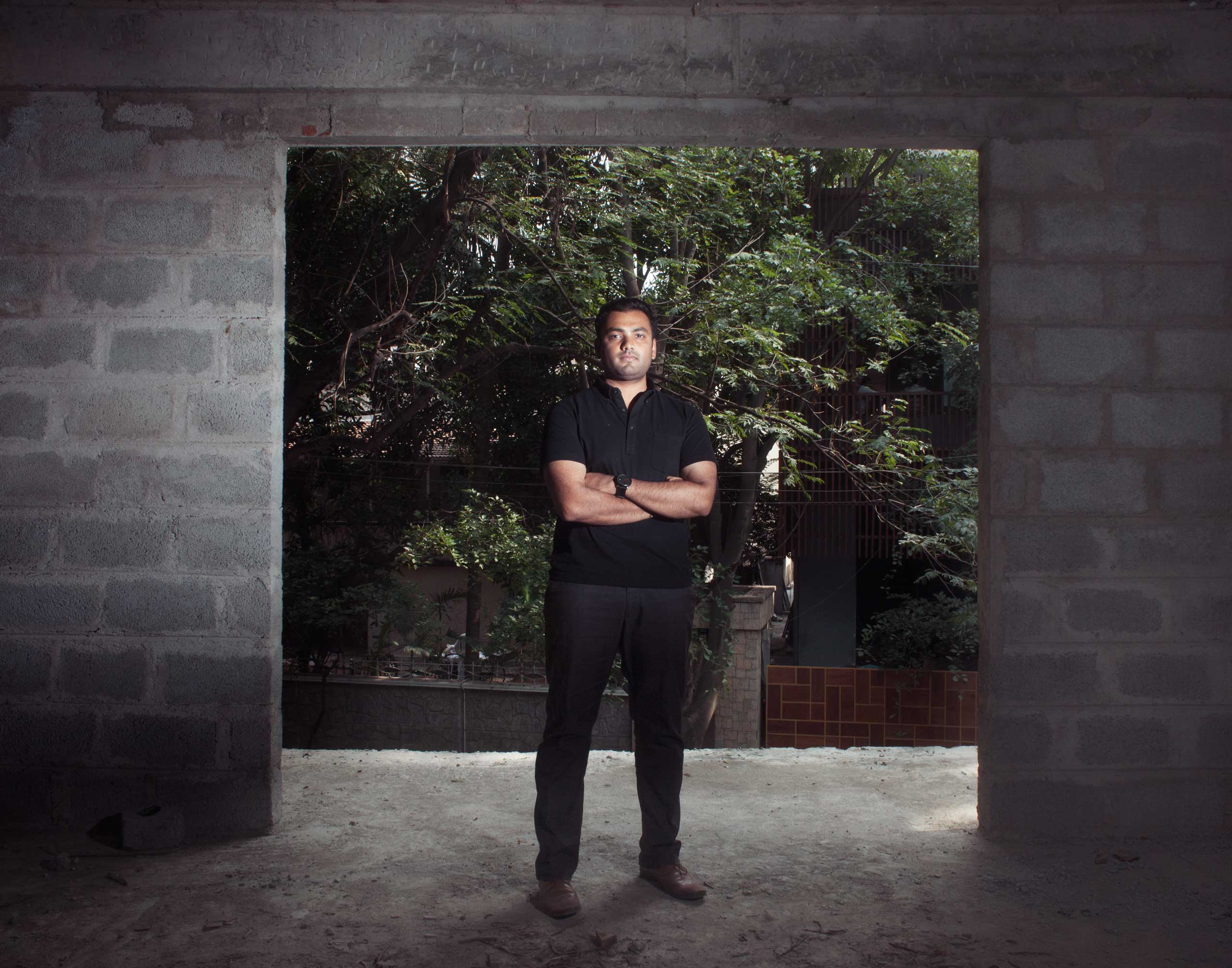 Architect Alok Shetty at one of his new construction sites in Bangalore, India on Aug. 20, 2014. He has designed an environmentally friendly house with folding walls.