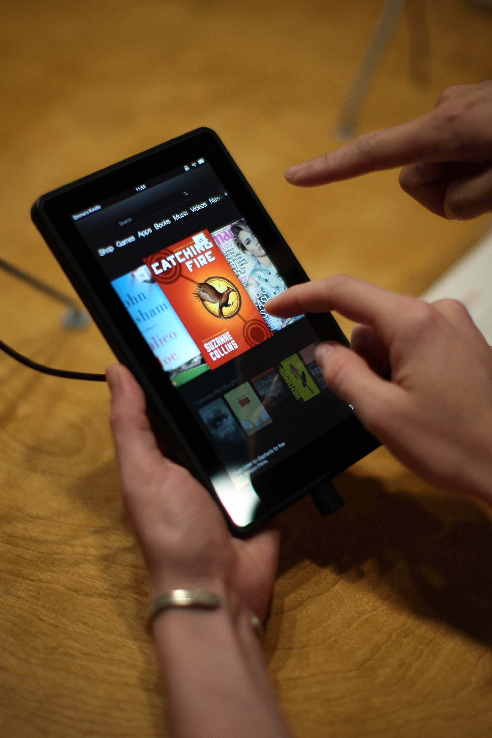 People try out a new Kindle fire reading device at a press conference on September 6, 2012 in Santa Monica, California.