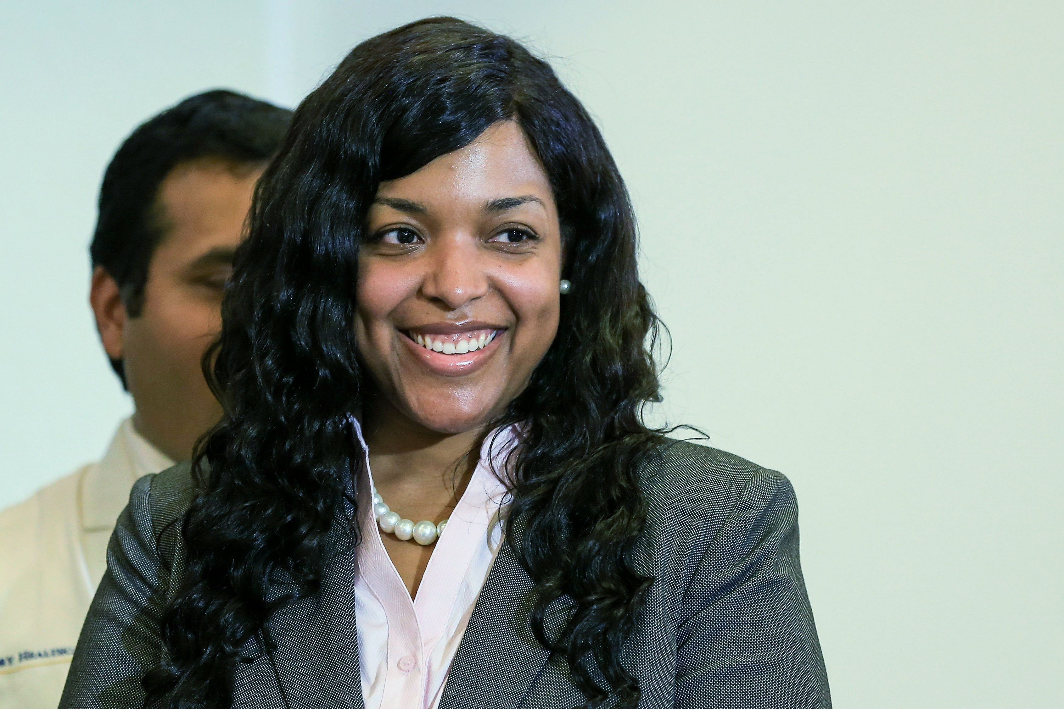 Amber Vinson (2nd R), a Texas nurse who contracted Ebola after treating an infected patient, stands during a press conference after being released from care at Emory University Hospital on August 1, 2014 in Atlanta, Georgia.
