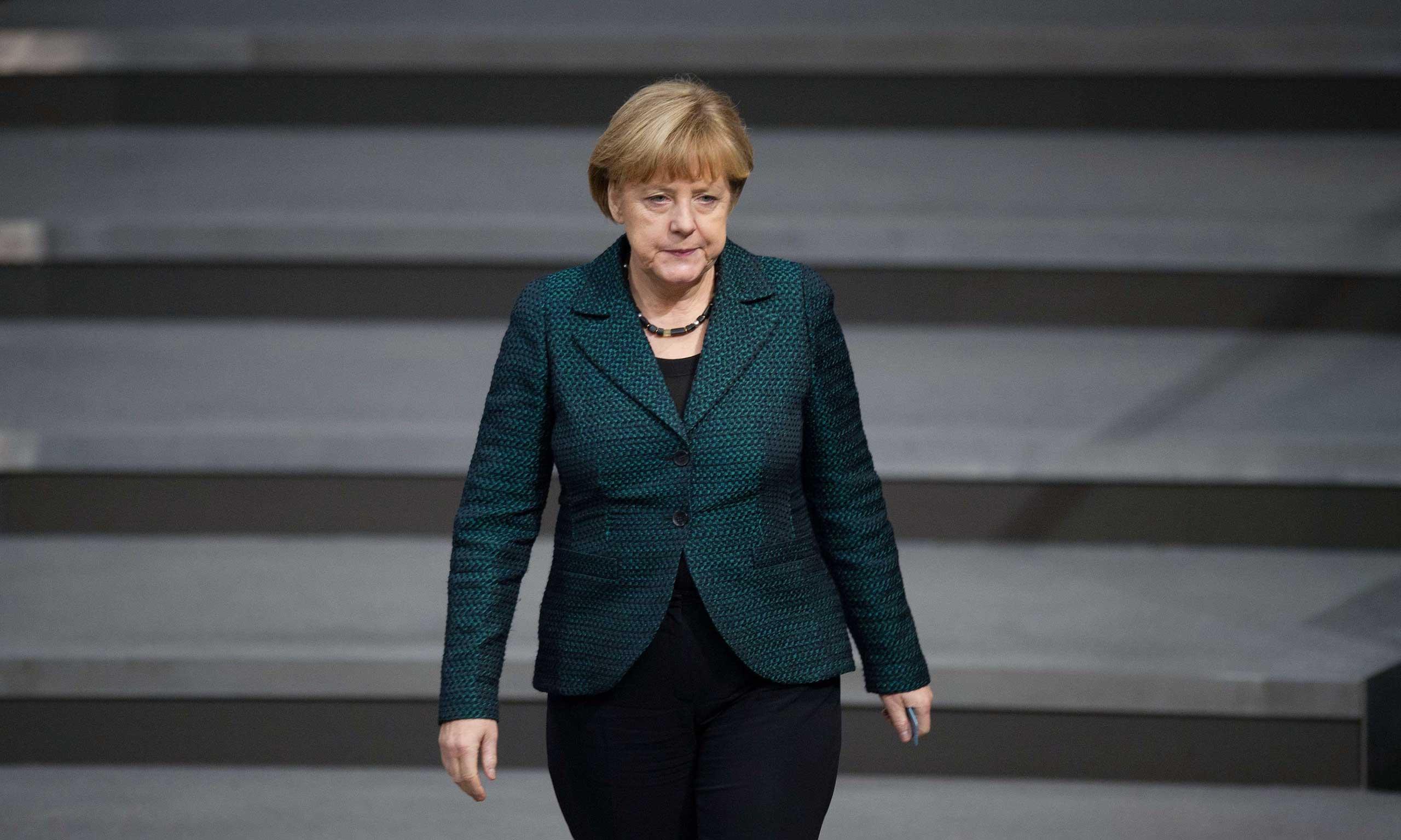 Chancellor Angela Merkel in the lower house of parliament Bundestag in Berlin, Nov. 26, 2014.
