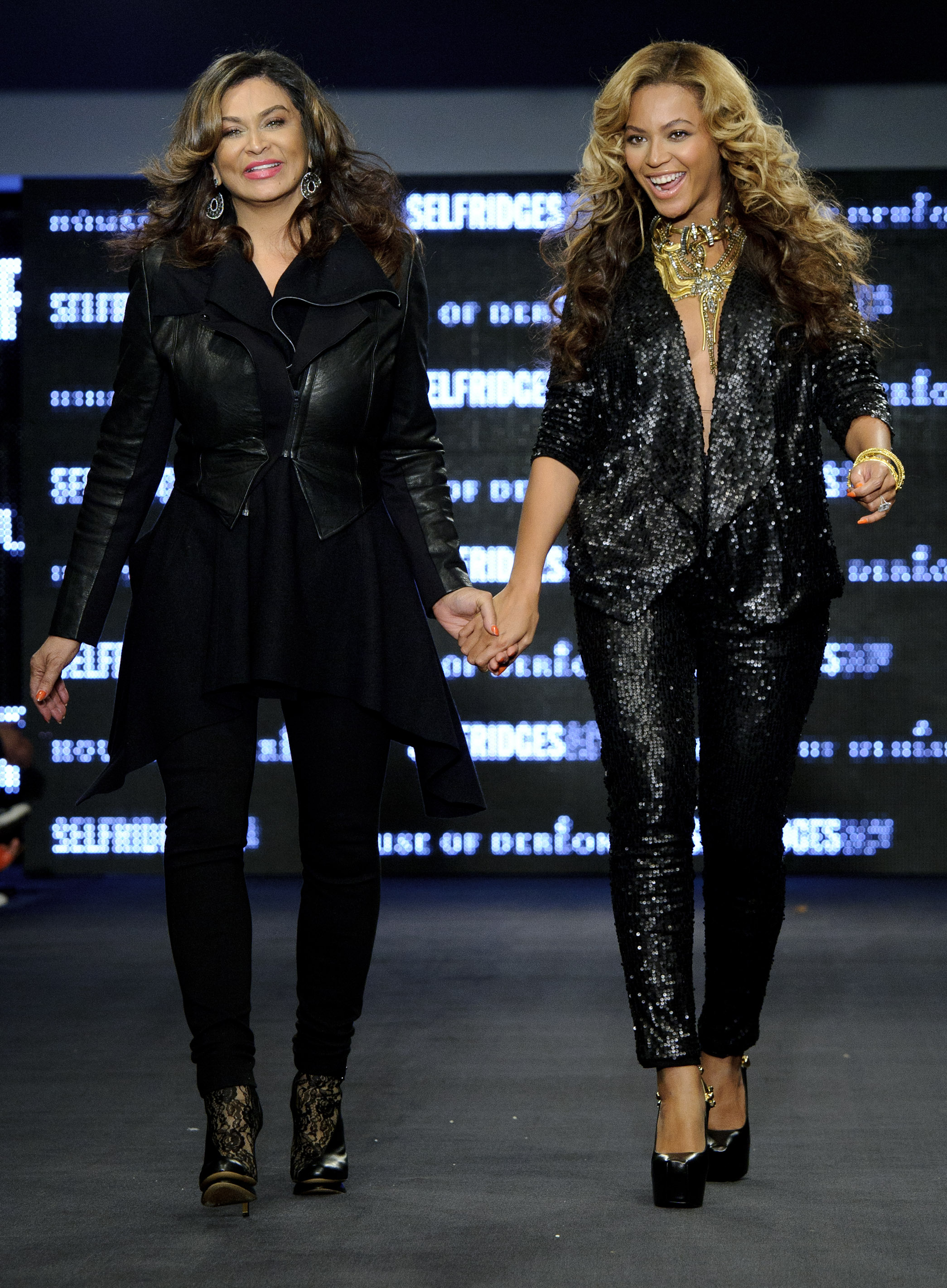 From left, U.S designer Tina Knowles and U.S singer Beyonce Knowles, launch their collection House of Dereon, featuring both the Autum-Winter and Summer 2011 collections, in London, during London Fashion week, Saturday, Sept. 17, 2011. (AP Photo/Jonathan Short)