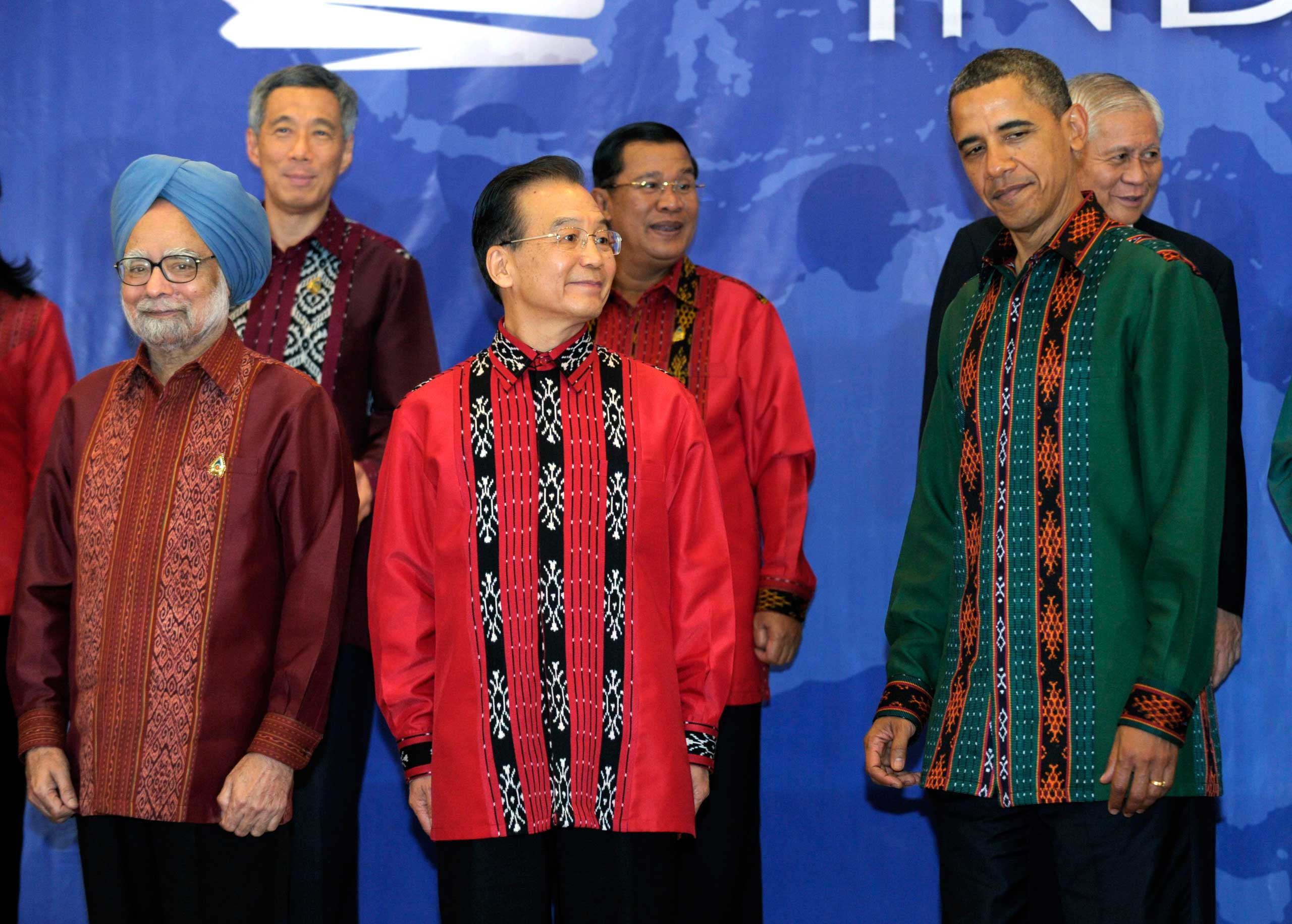 President Barack Obama stands with China's Premier Wen Jiabao, center, as they wait to take a photo at the East Asia Summit Gala dinner in Nusa Dua, on the island of Bali in Indonesia in 2011.