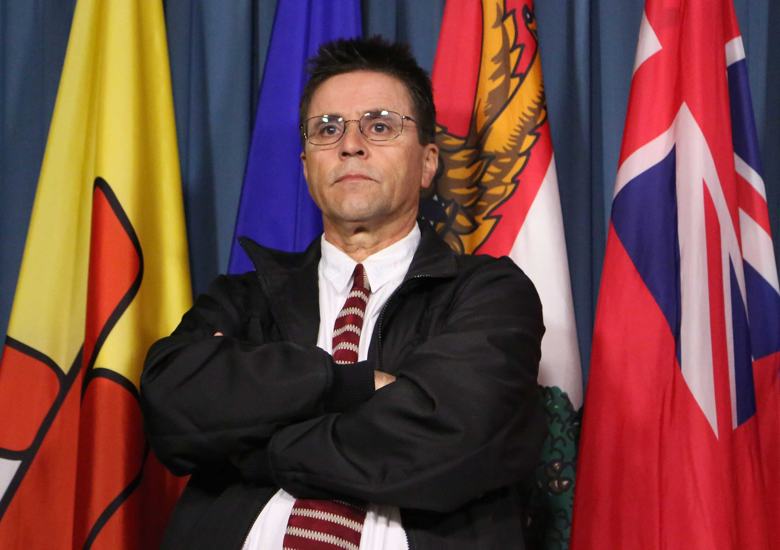 Hassan Diab, the Ottawa professor who has been ordered extradited to France by the Canadian government, listens to his lawyer speak at a press conference on Parliament Hill in Ottawa, April 13, 2012.