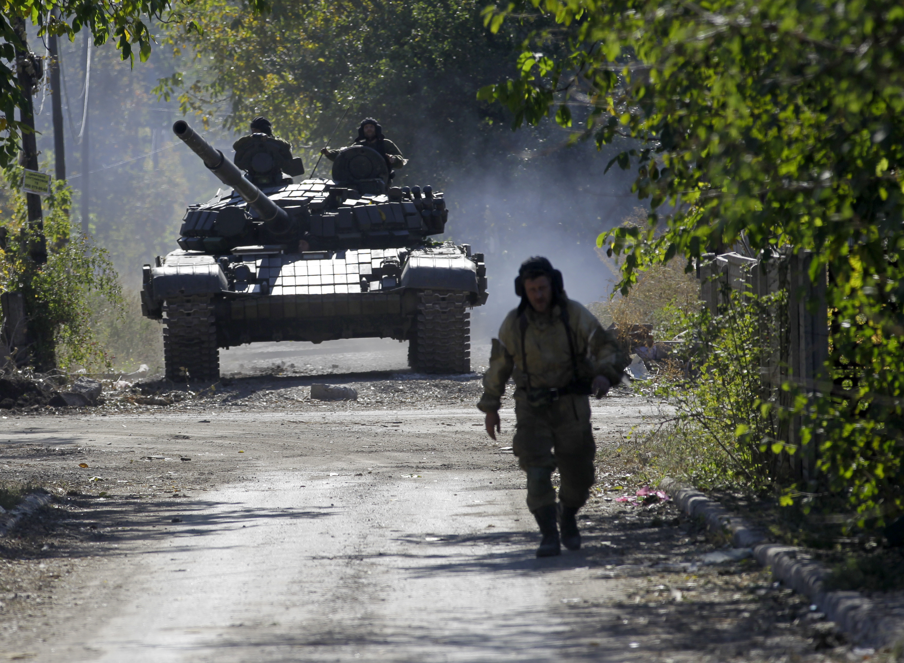 A pro-Russian rebel tank rolls to take position near to the airport in the town of Donetsk, eastern Ukraine, Friday, Oct. 3, 2014.