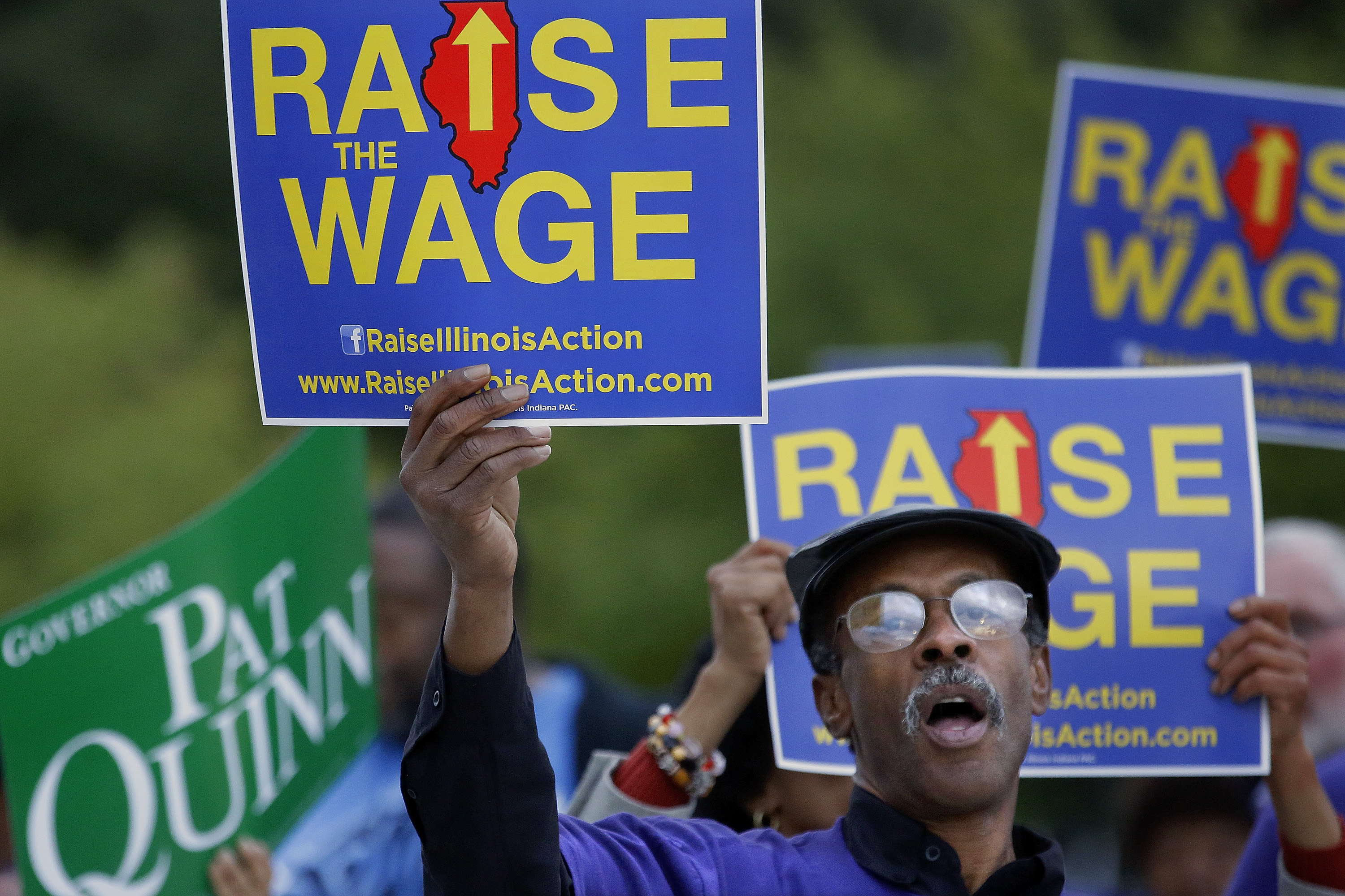 Minimum wage supporters rally outside an Illinois gubernatorial debate on Oct. 9, 2014.