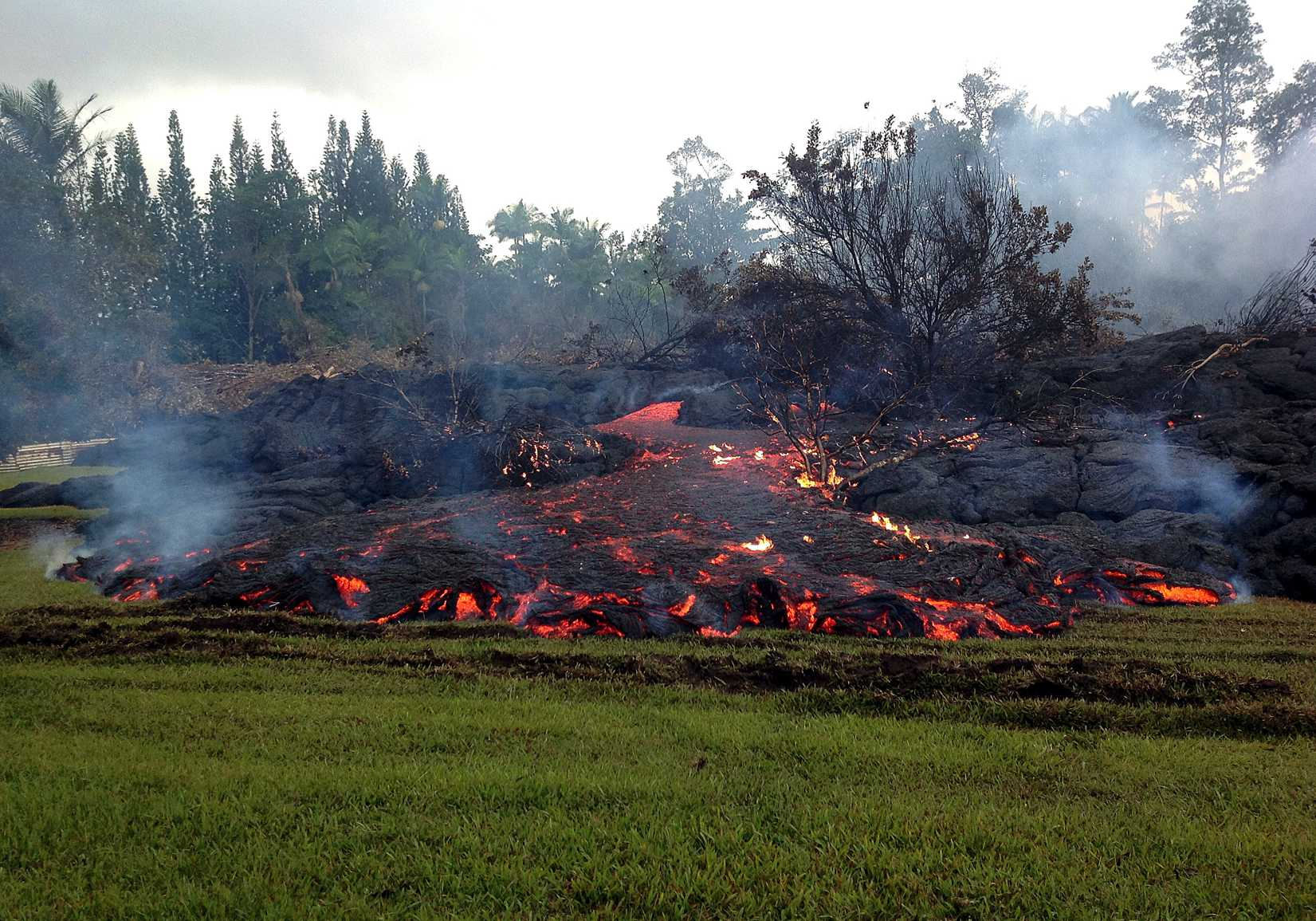 This Nov. 2, 2014 photo provided by the U.S. Geological Survey shows a breakout from an inflated lobe of the June 27 lava flow near the town of Pahoa on the Big Island of Hawaii.