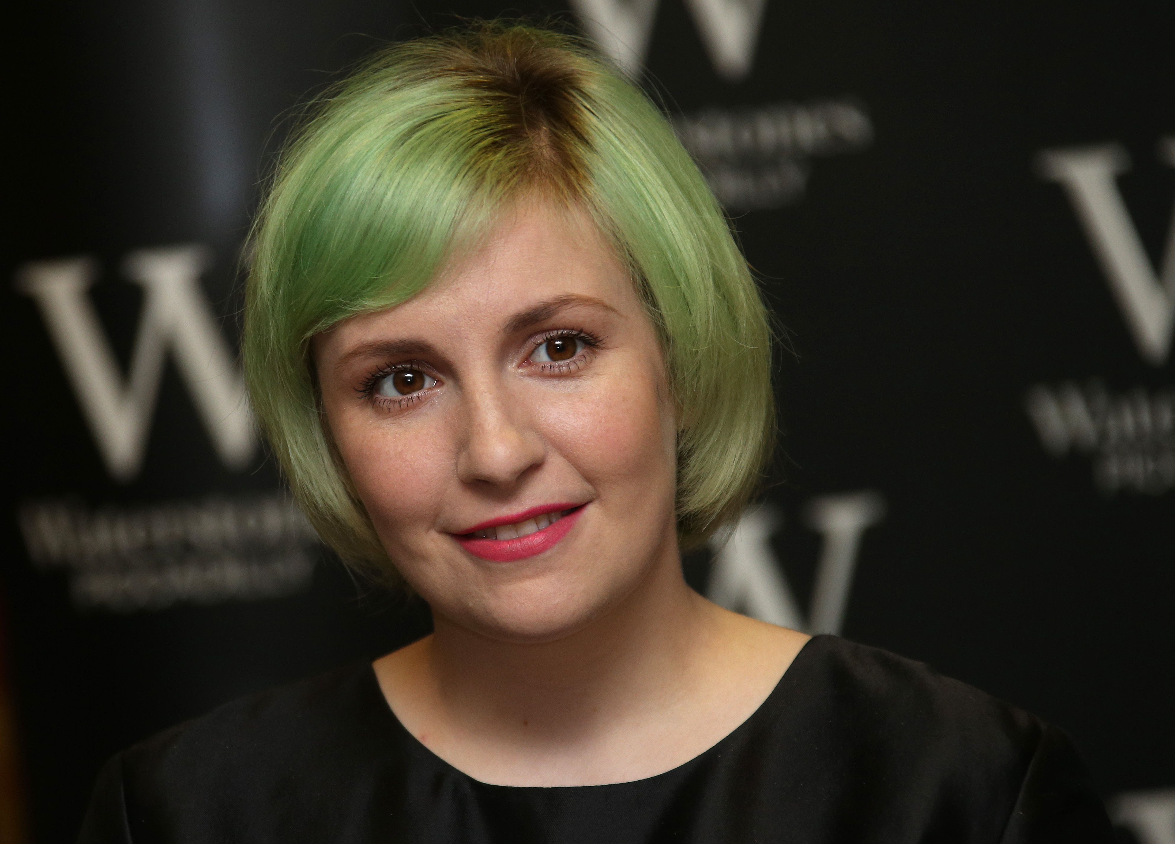 U.S actress Lena Dunham holds her memoir, Not That Kind Of Girl, ahead of a book signing at Waterstones, Piccadilly in central London, Wednesday, Oct. 29, 2014