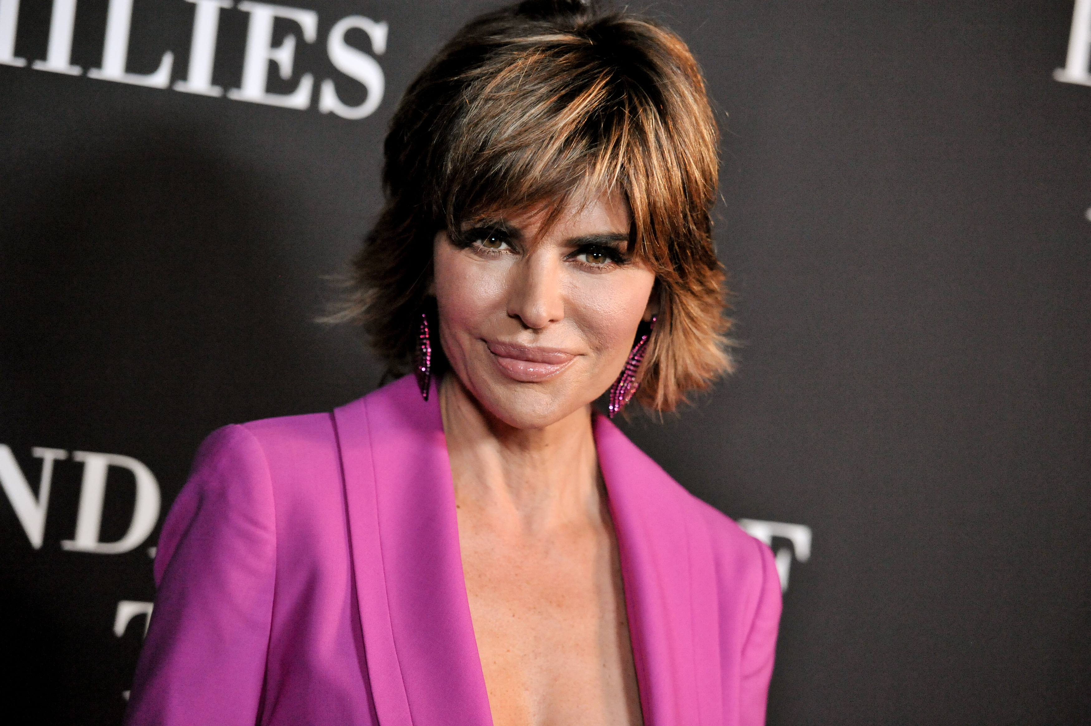 Lisa Rinna arrives at Elyse Walker's 10th Annual Pink Party on Saturday, Oct. 18, 2014, in Santa Monica, Calif. (Photo by Richard Shotwell/Invision/AP)