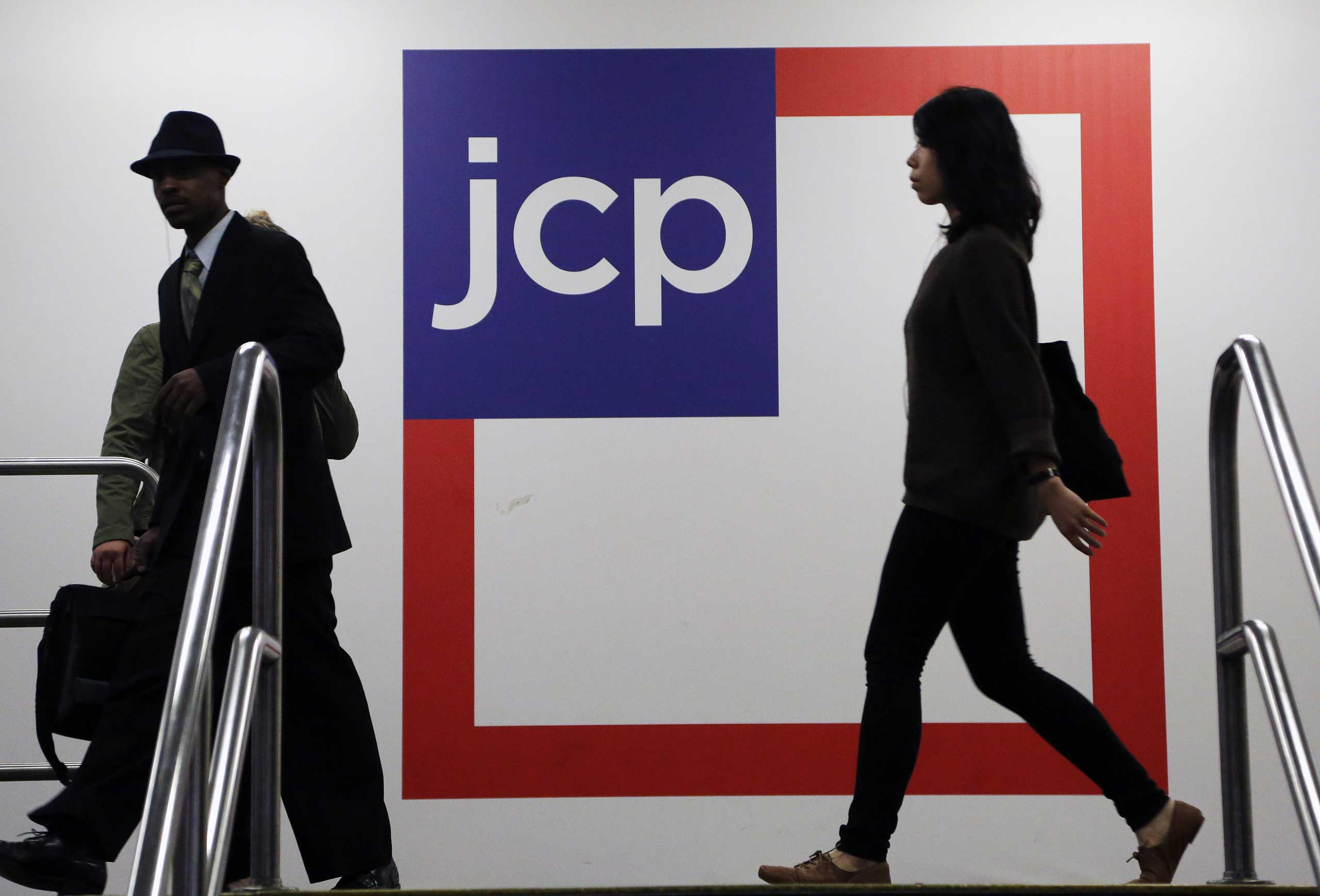 In this April 9, 2013 file photo, customers arrive at a J.C. Penney store in New York.